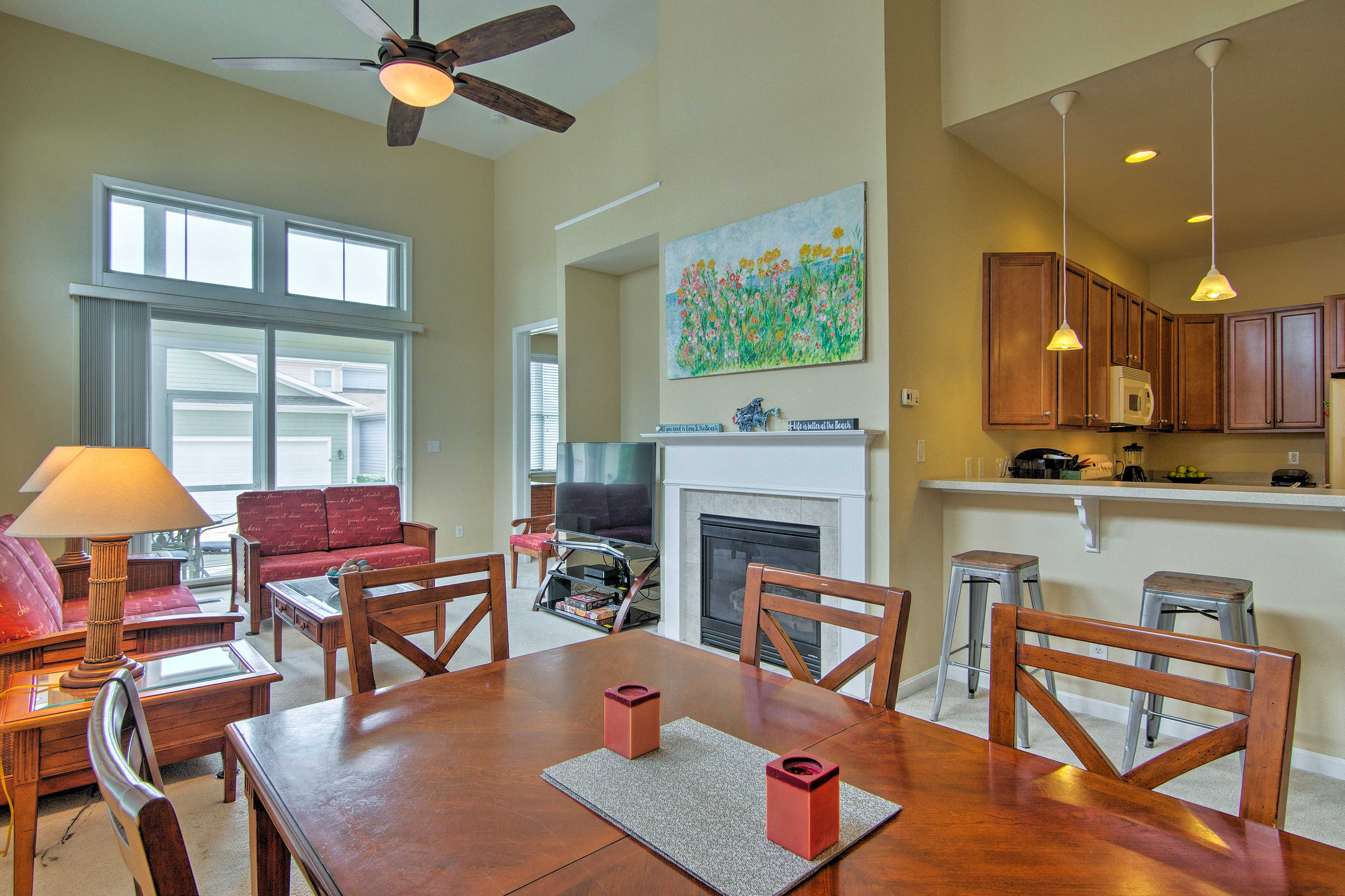 The open floor plan seamlessly connects the living room, dining area and kitchen.