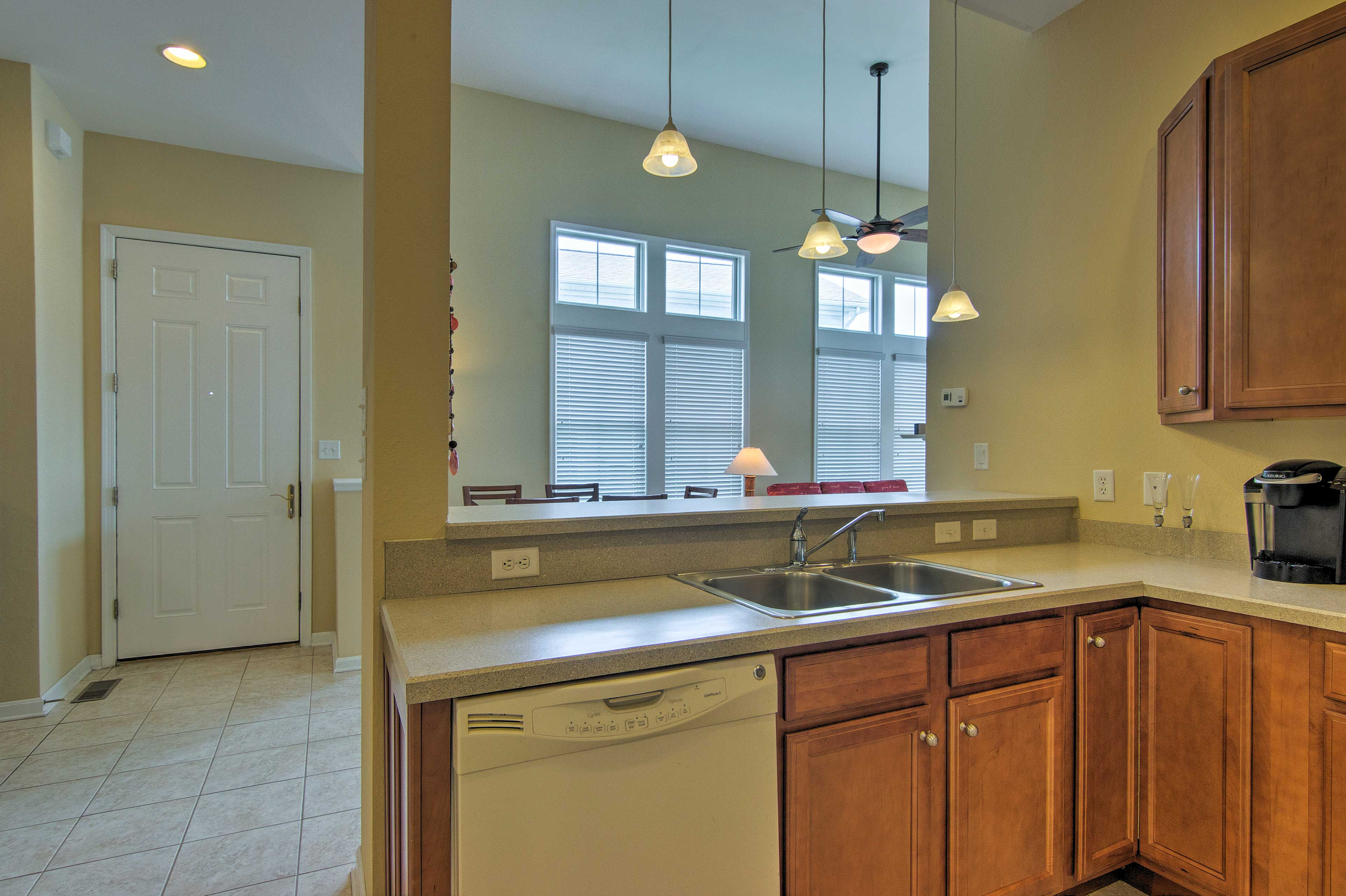 A pass through window in the kitchen lets you chat with your group as you cook.