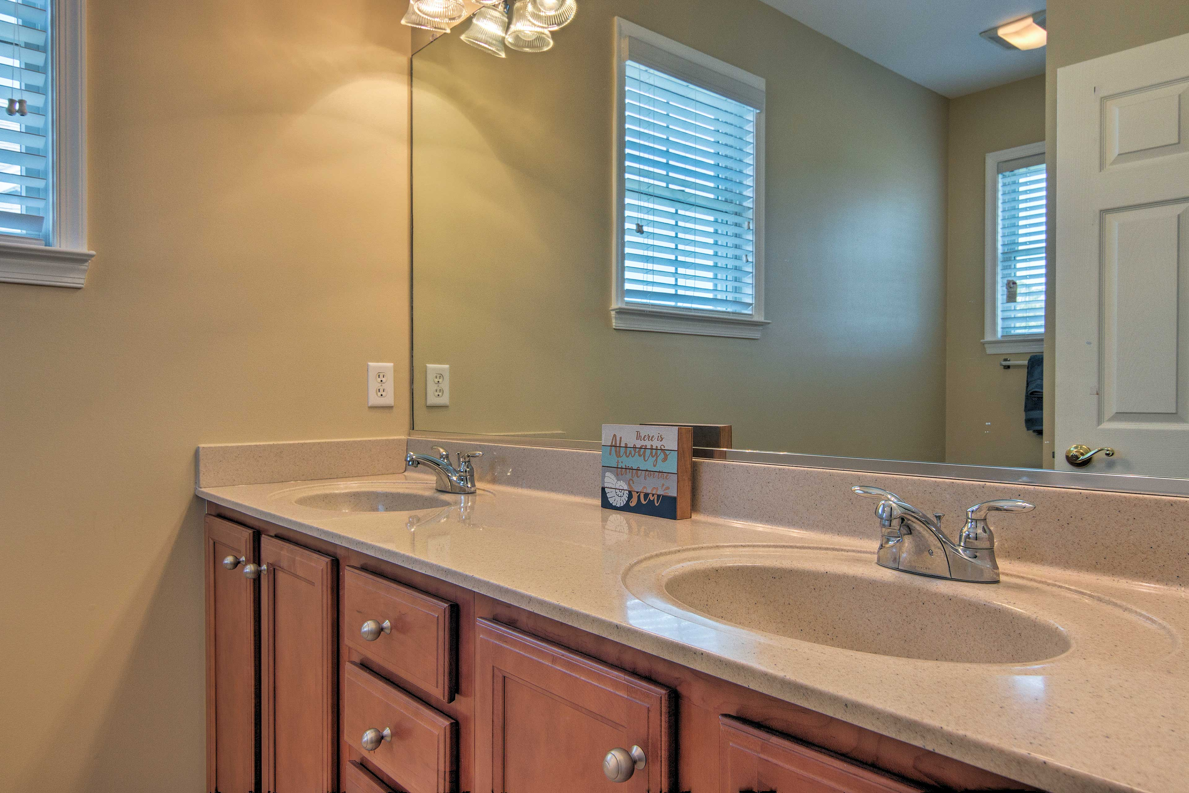 A full bathroom with double sinks is set on the main floor for your convenience.