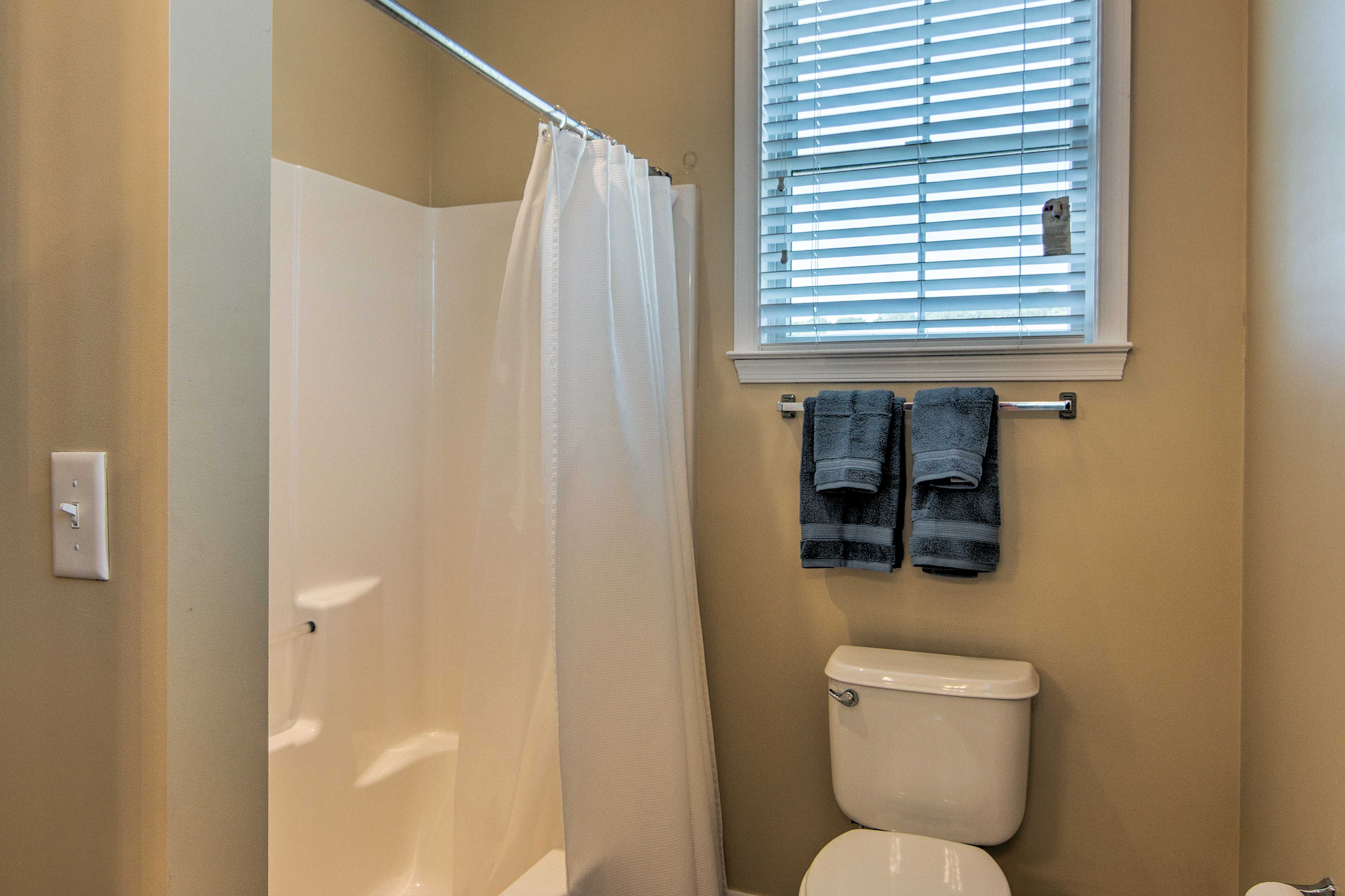 Rinse your worries away in the shower/tub combo full bathroom.