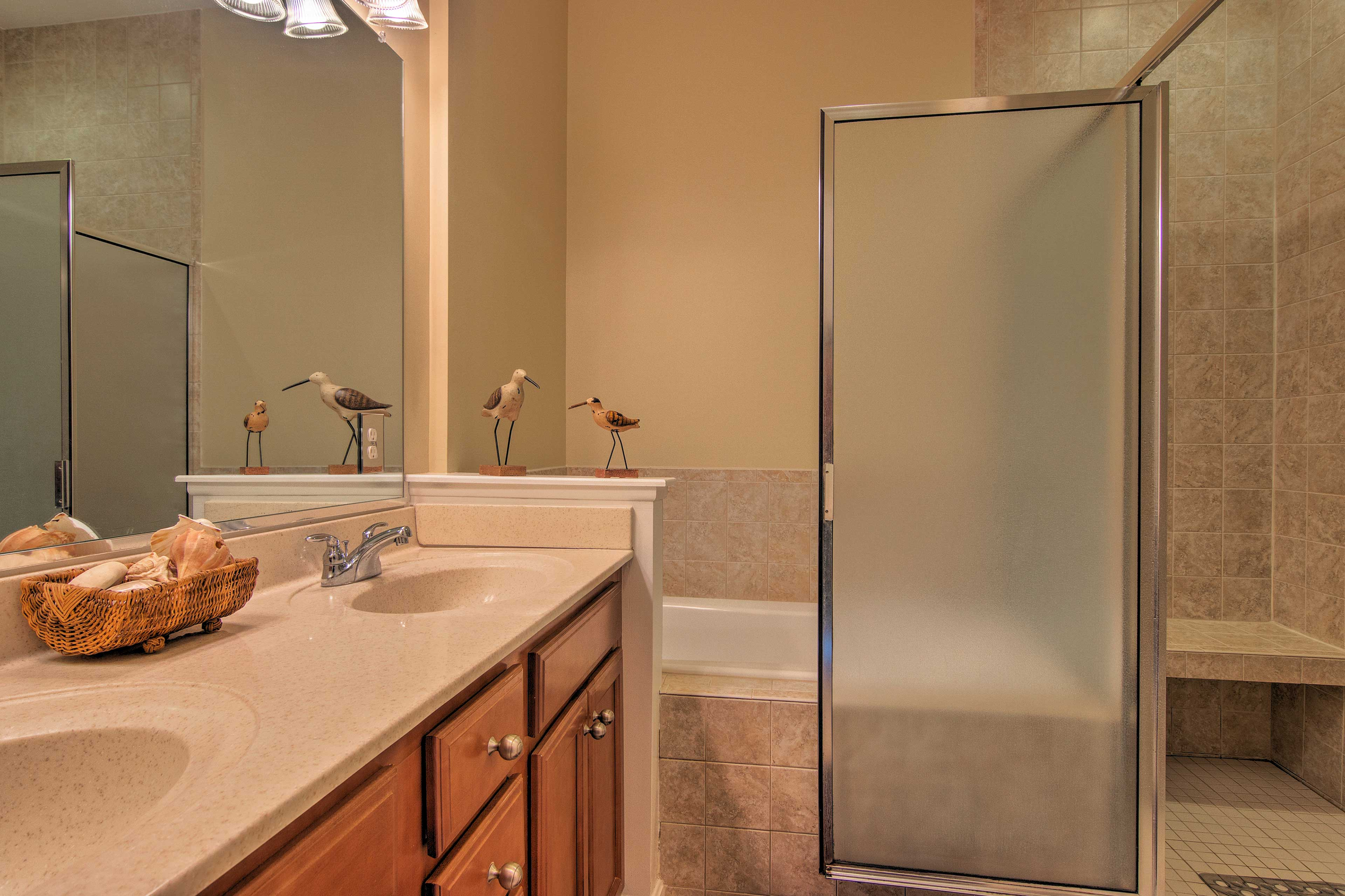The master bathroom has a tub and a sitting shower for your enjoyment.