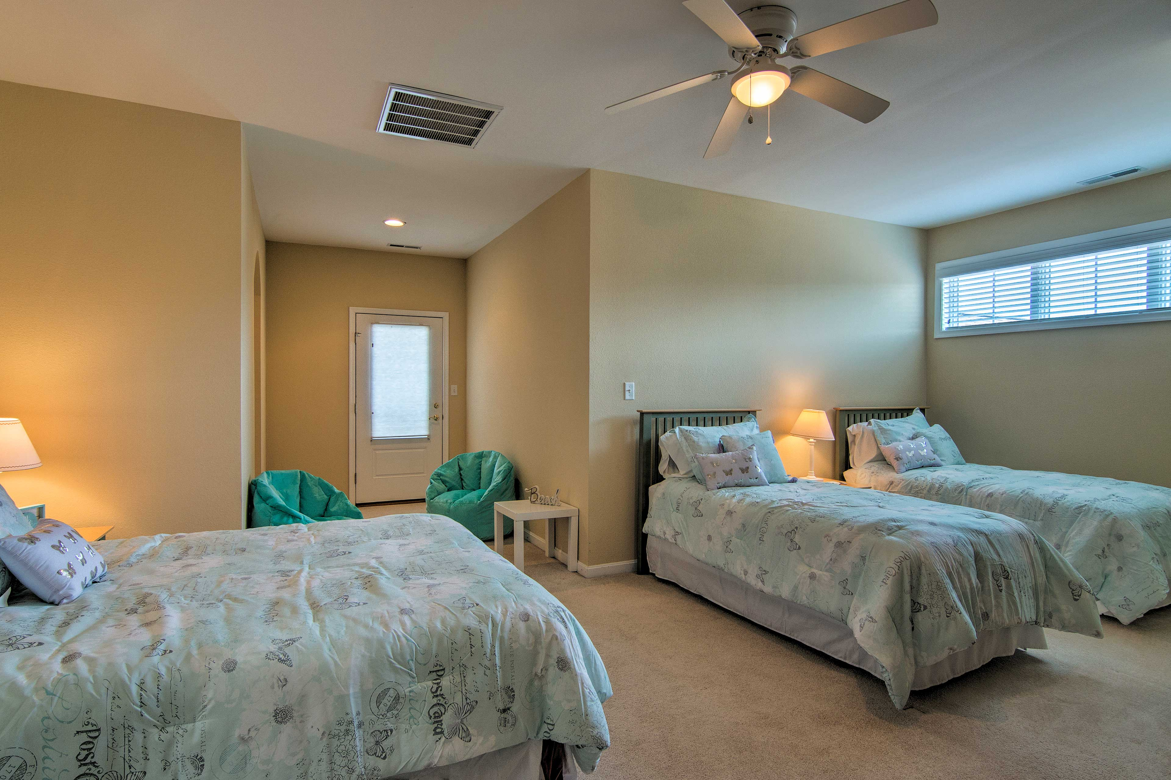 An upstairs bedroom boasts a queen bed and 2 twin beds for blissful sleeping.