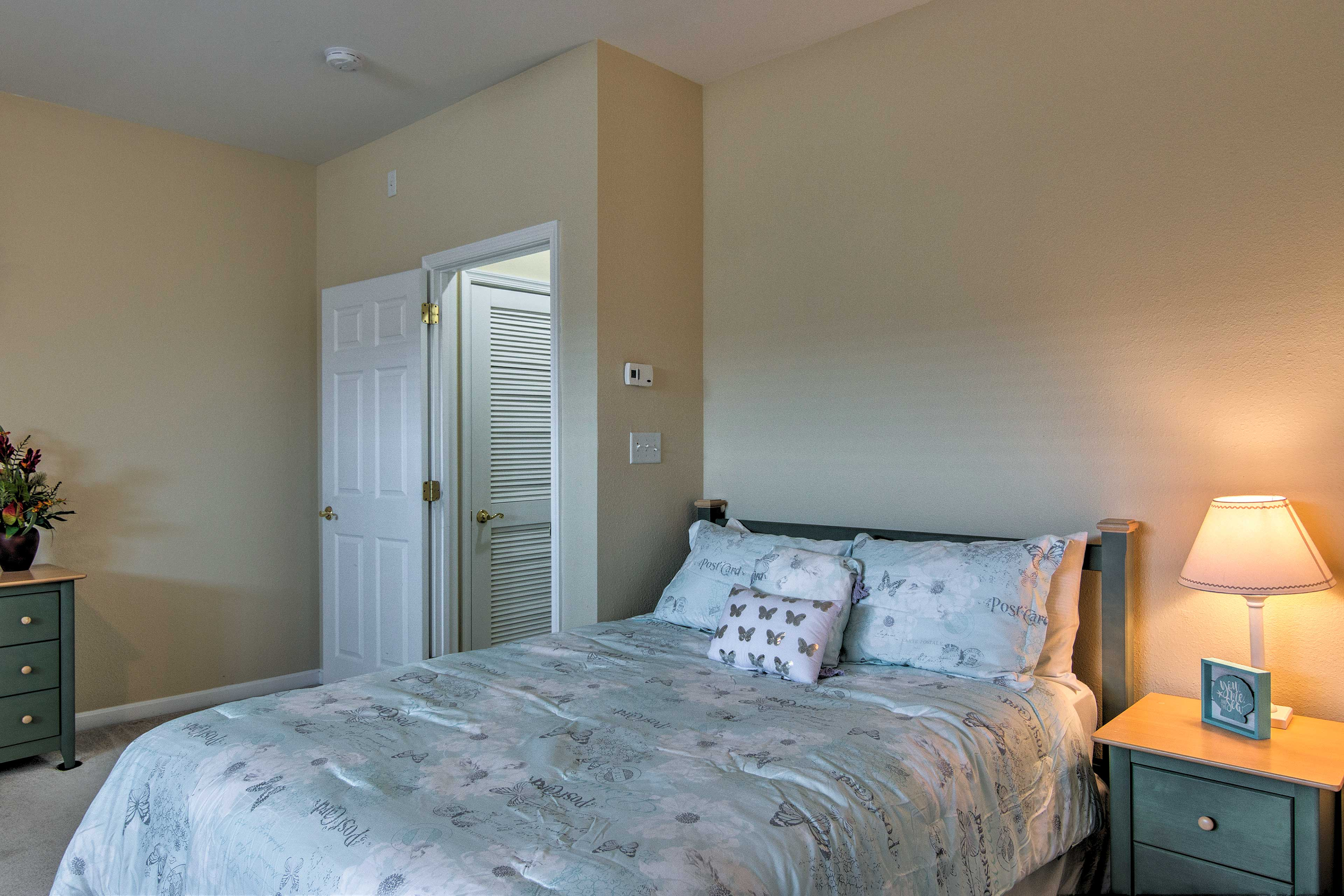 Beachy decor and soft bedding complete the tranquil sleeping setting.