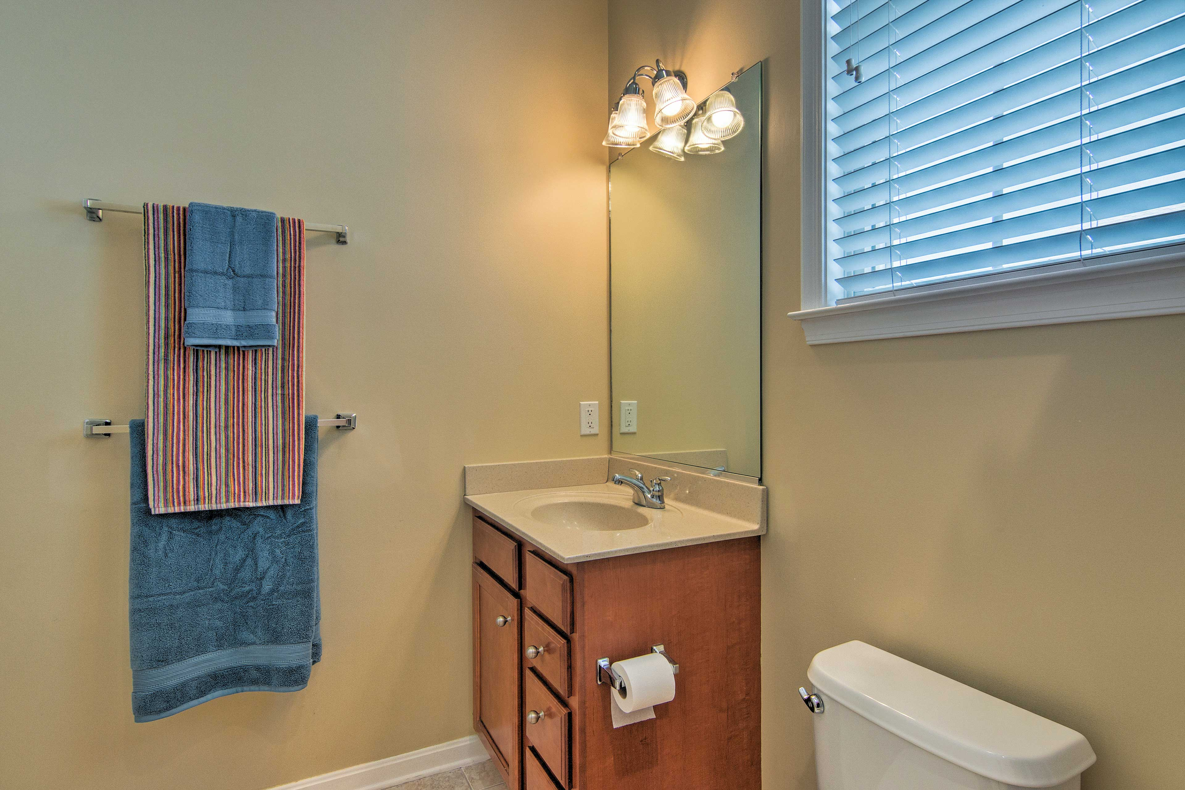 A full bathroom with colorful details is located upstairs.