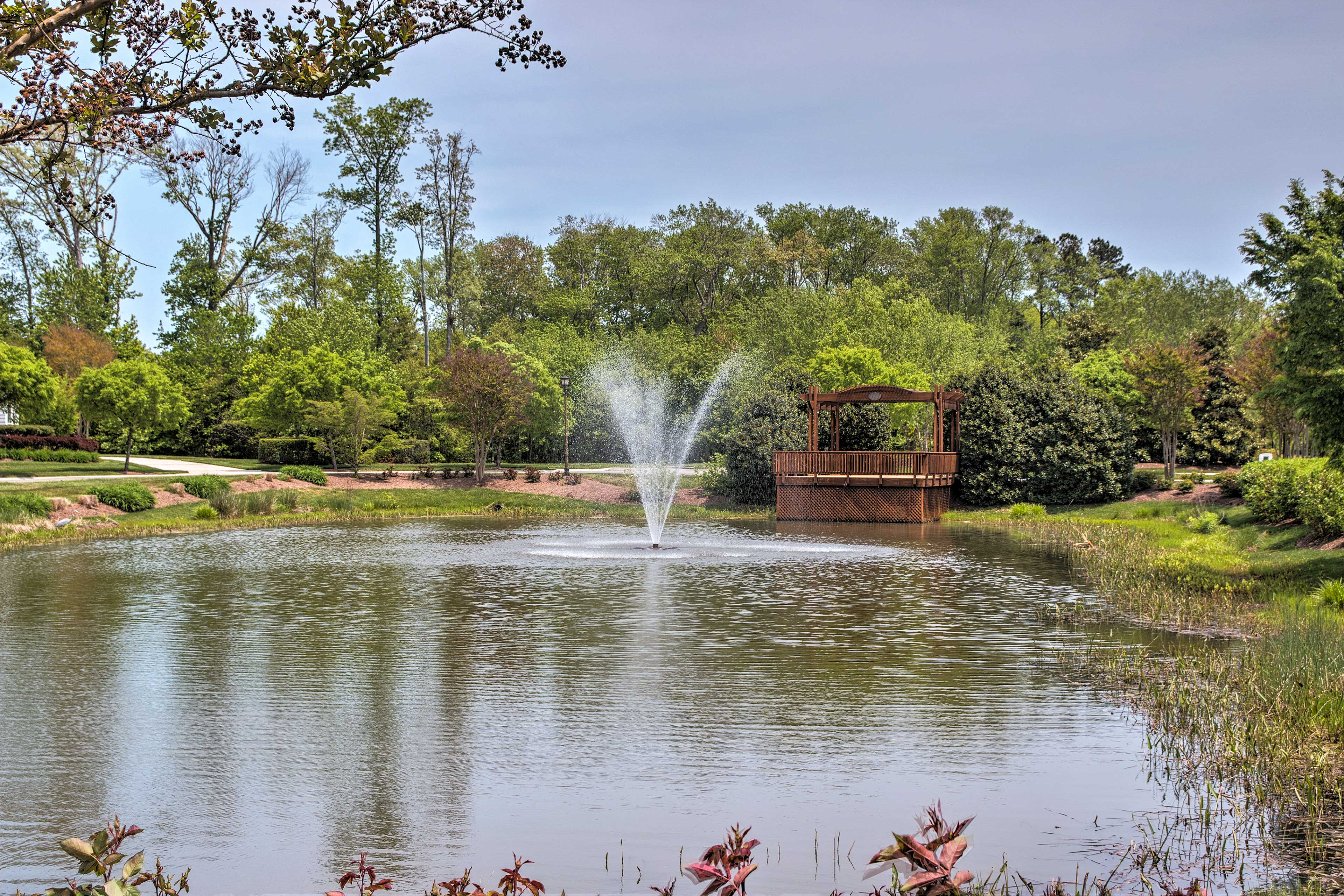Stroll over to the nearby pond with a fountain and pergola.
