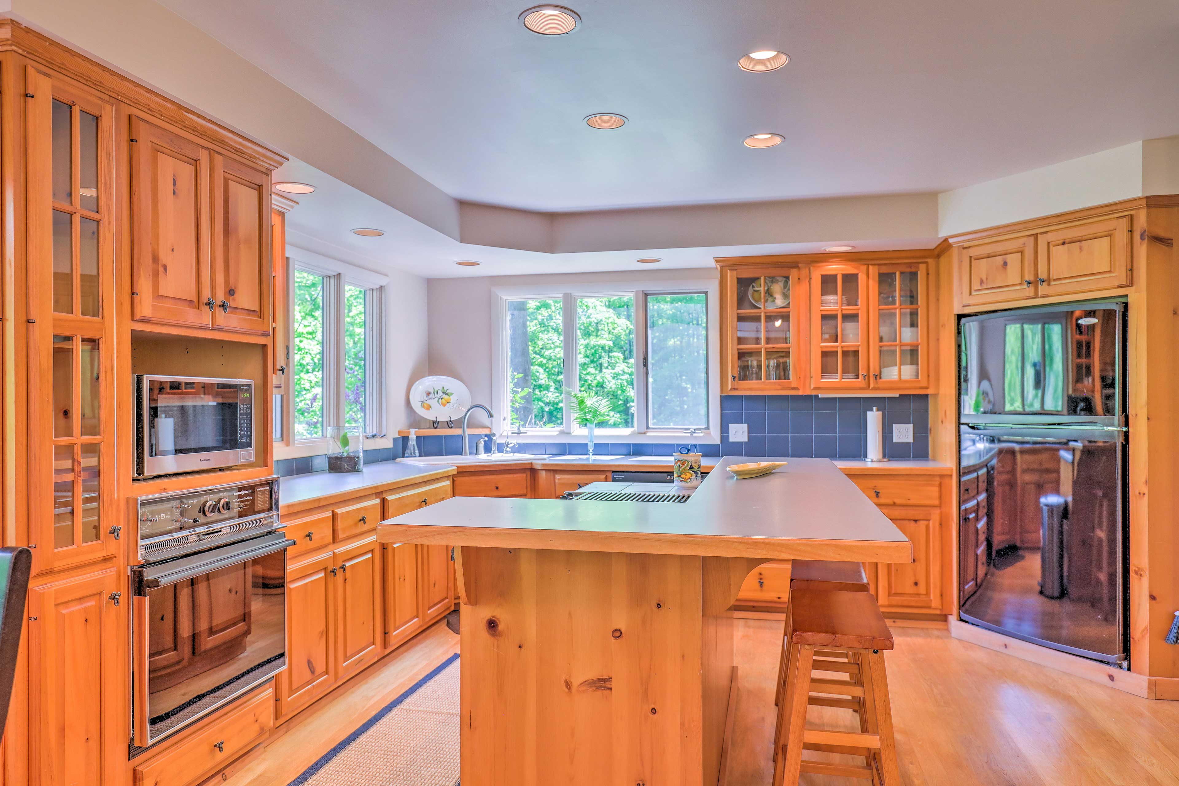 Sleek wood paneling details the fully equipped kitchen.