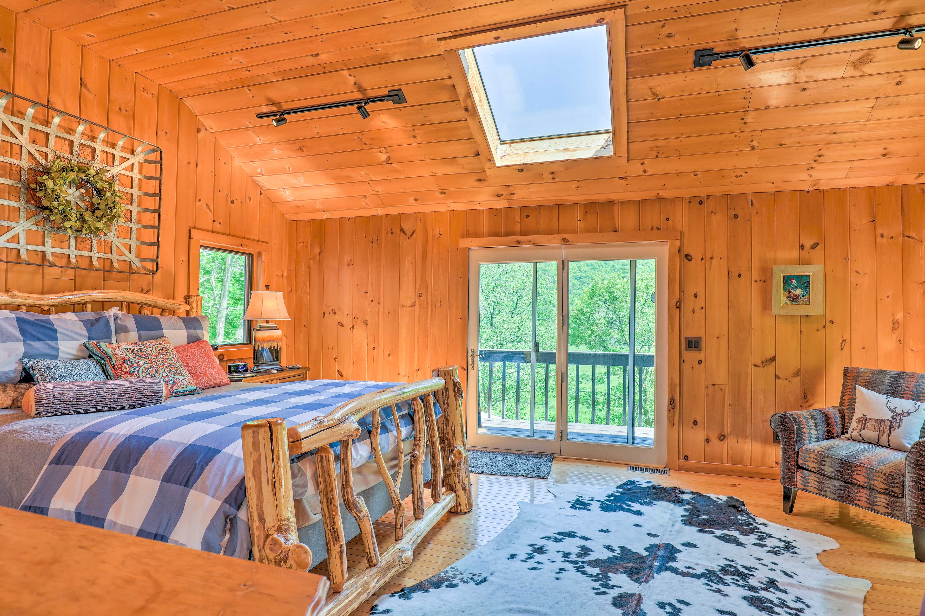 Upstairs, the master bedroom exudes rustic charm and warm comfort.