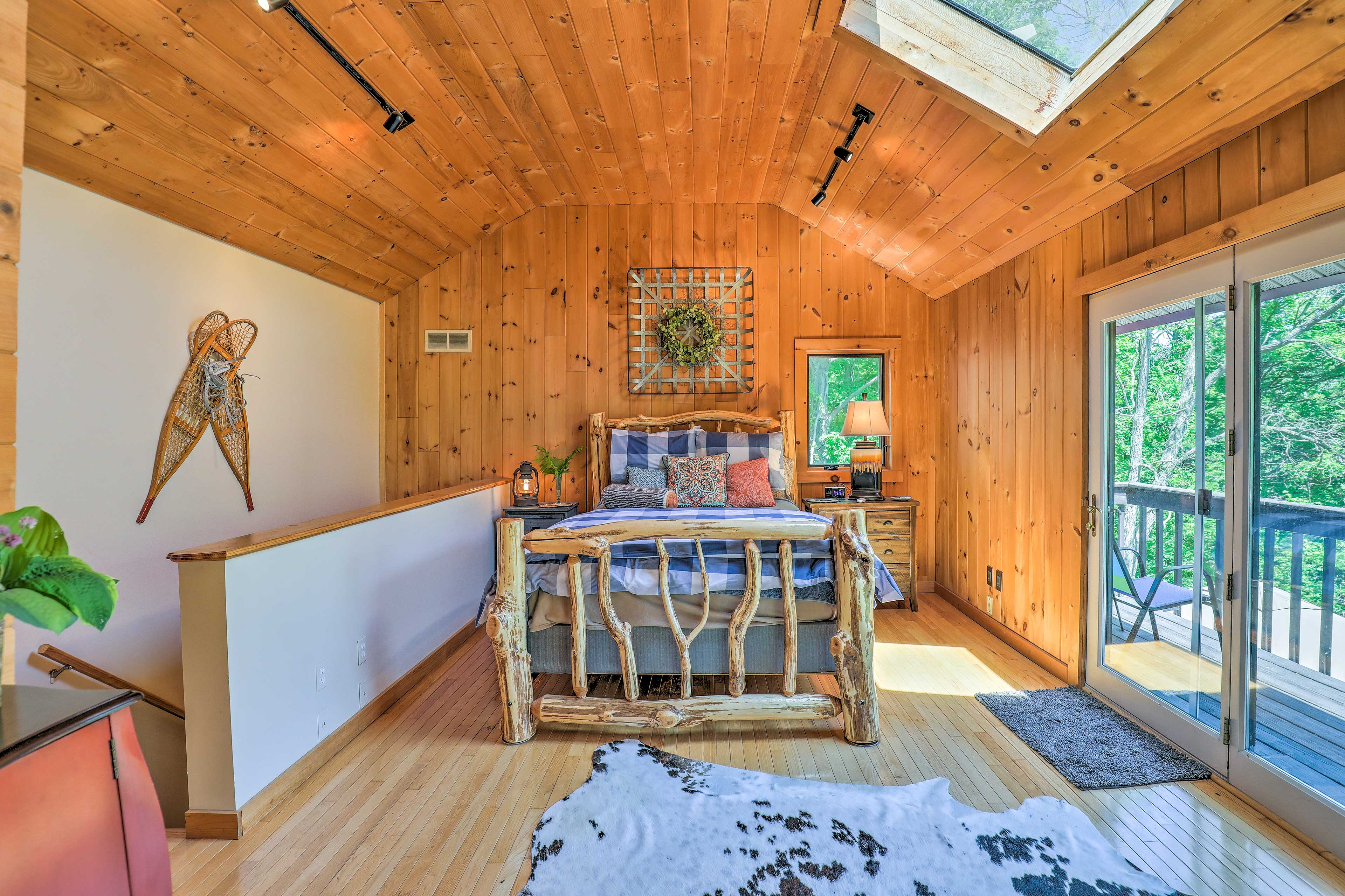 Skylights and mountain-themed decor complete the bedroom oasis.