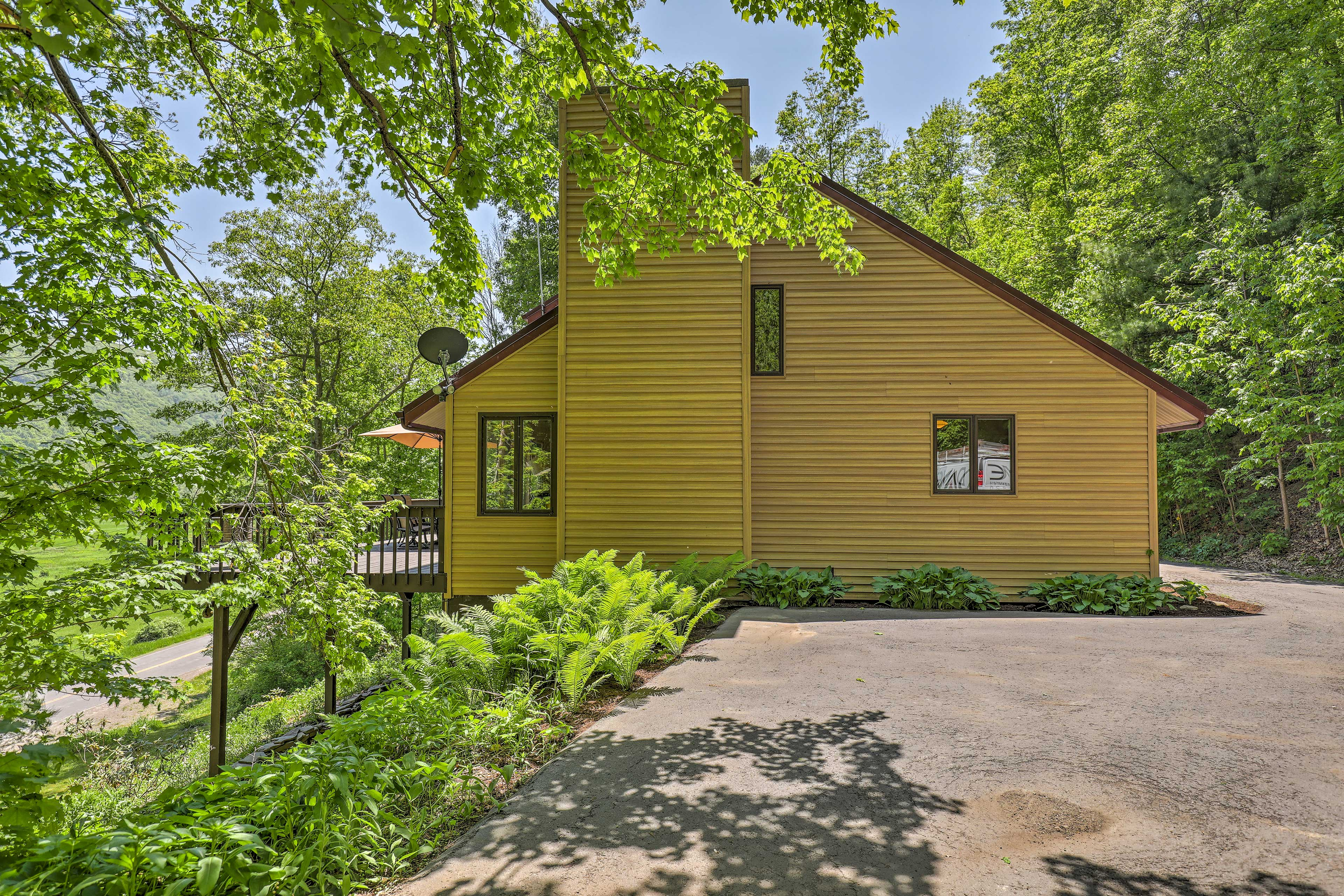 The house is nestled on 6 private acres of lush forest landscape.