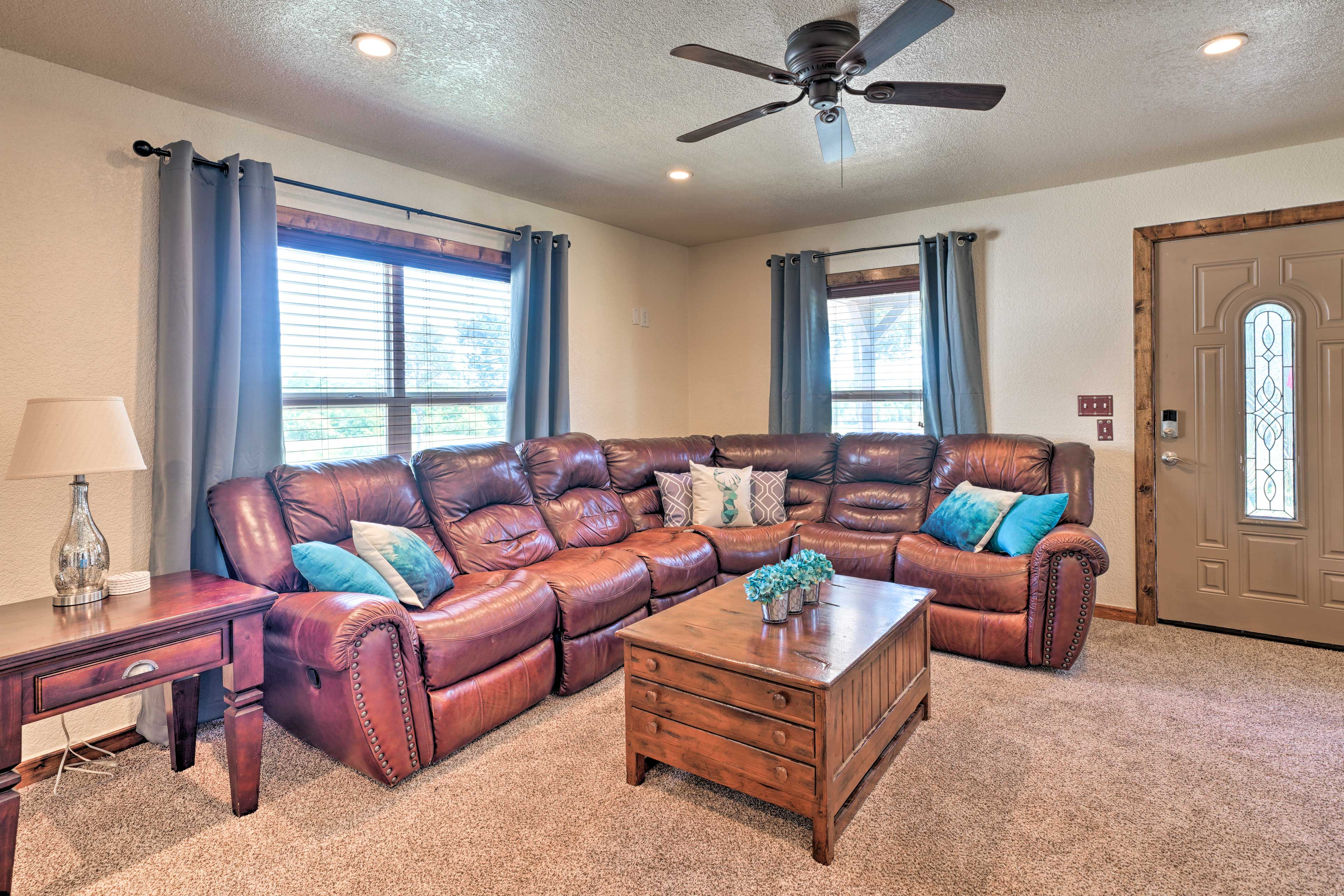 Lounge on the plush leather L-shaped sectional as you unwind.