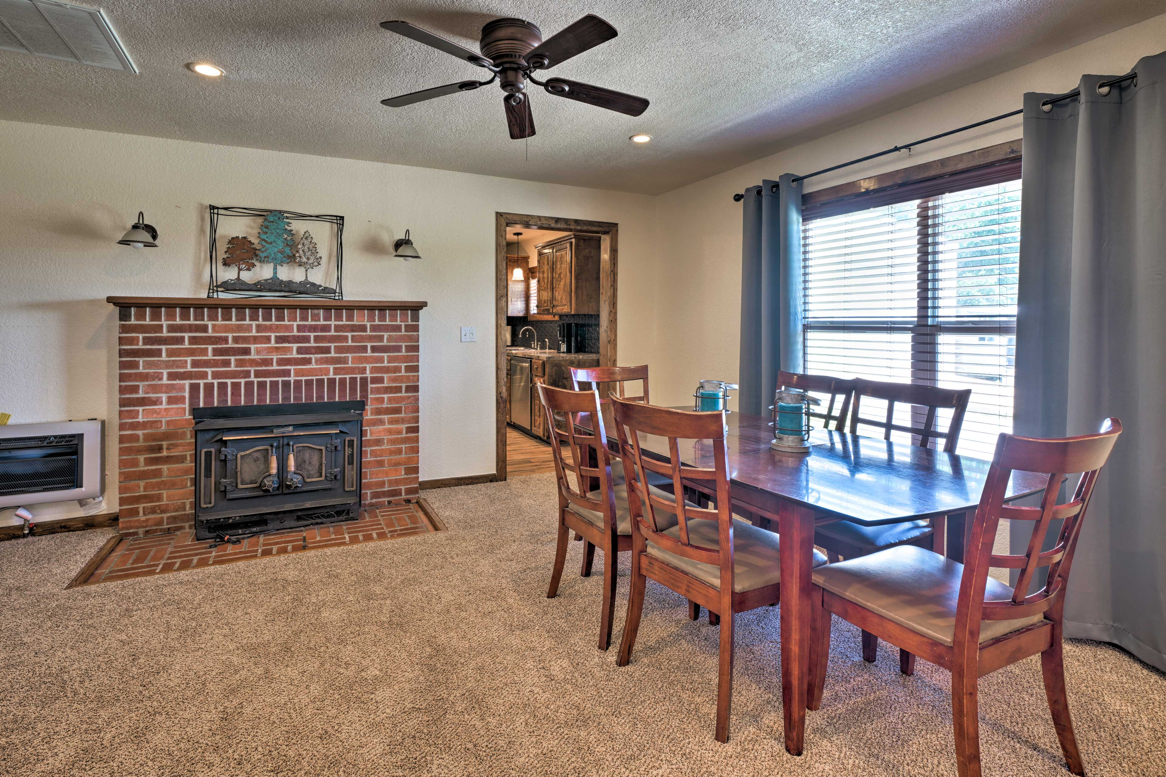 Savor home-cooked meals at the 6-person hardwood dining table.