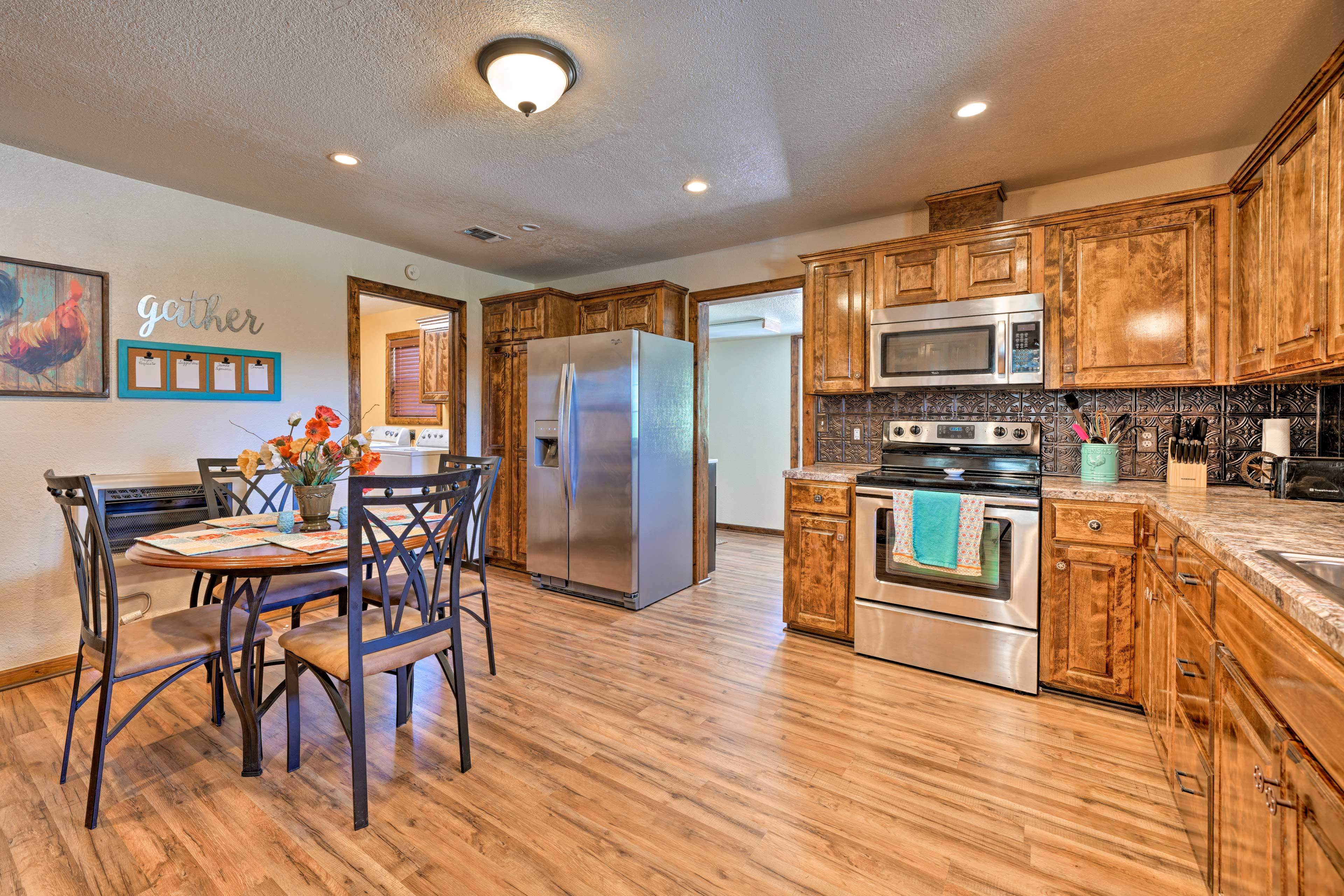 Hardwood floors line the roomy fully equipped kitchen.