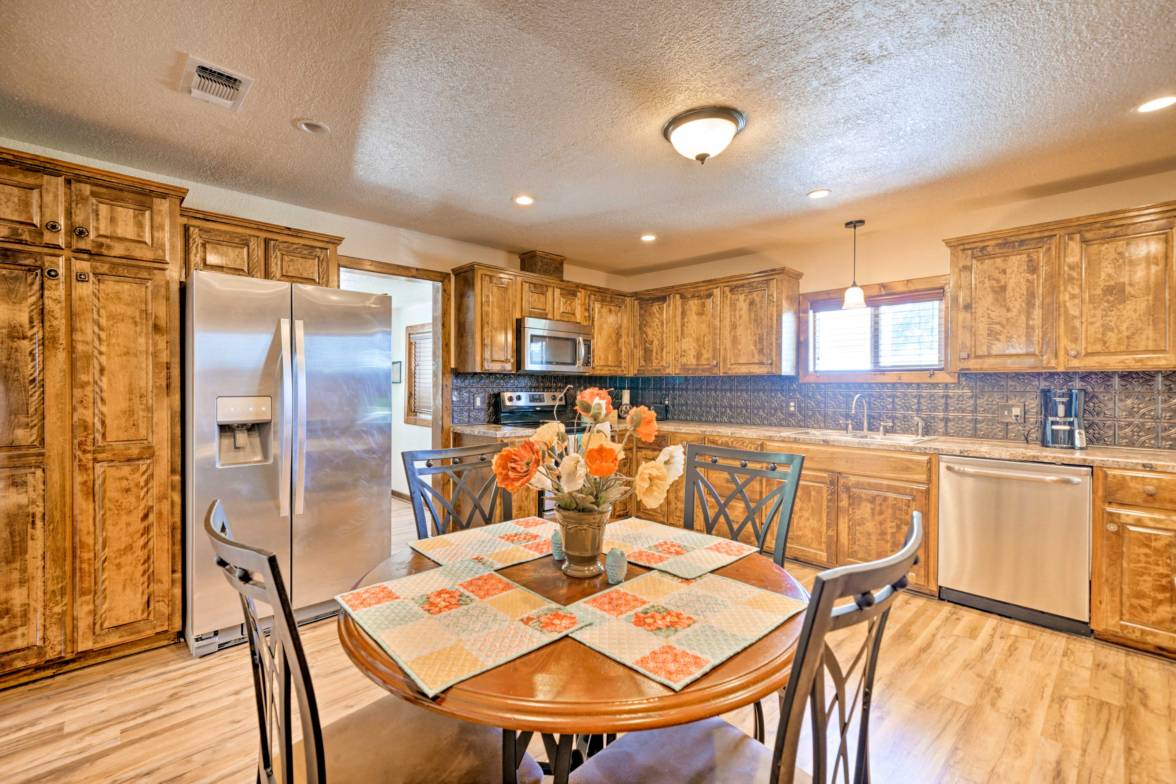 A 4-person dining table furnishes the cooking space.