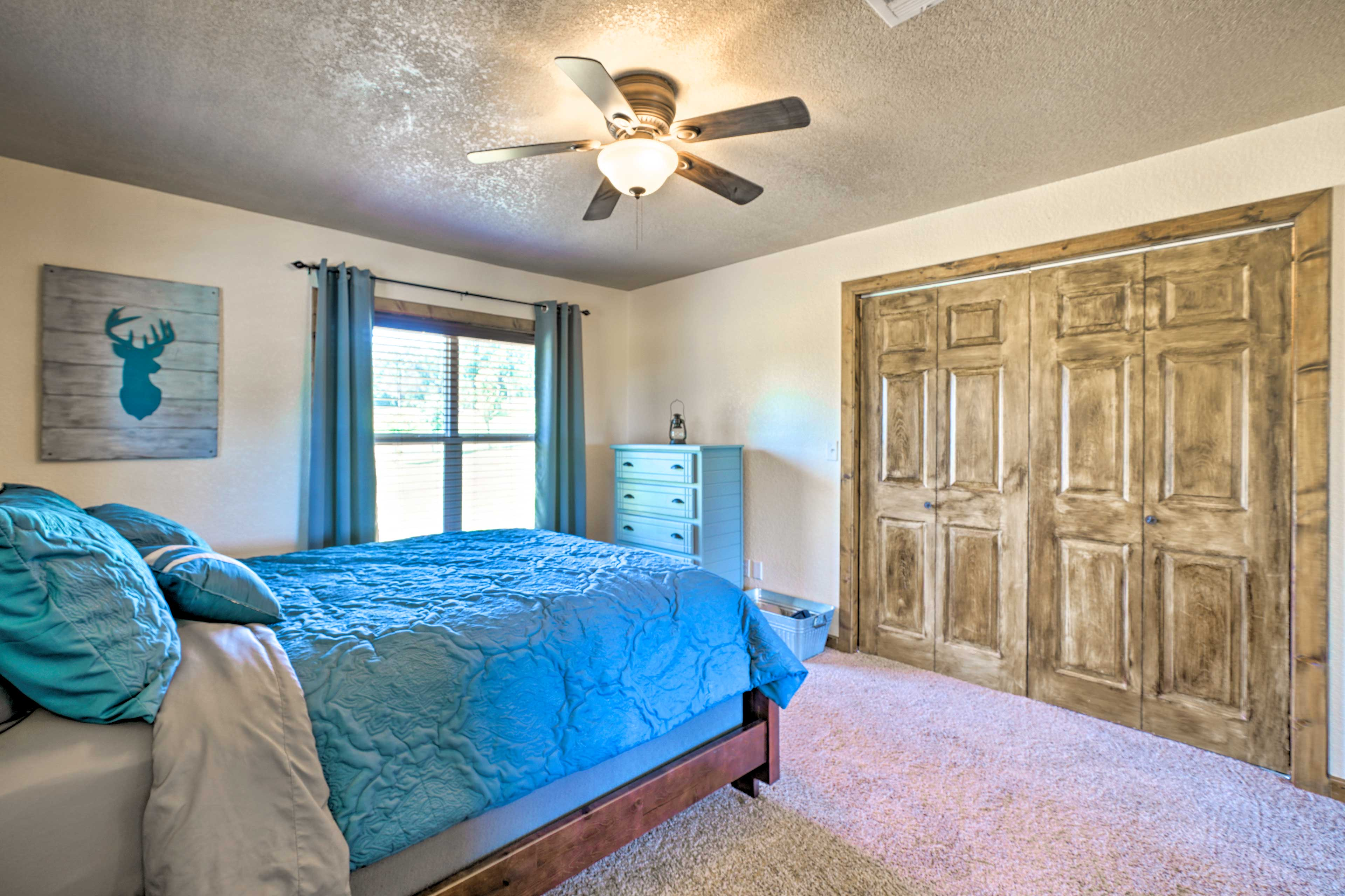A queen bed and spacious closet complete the bedroom.