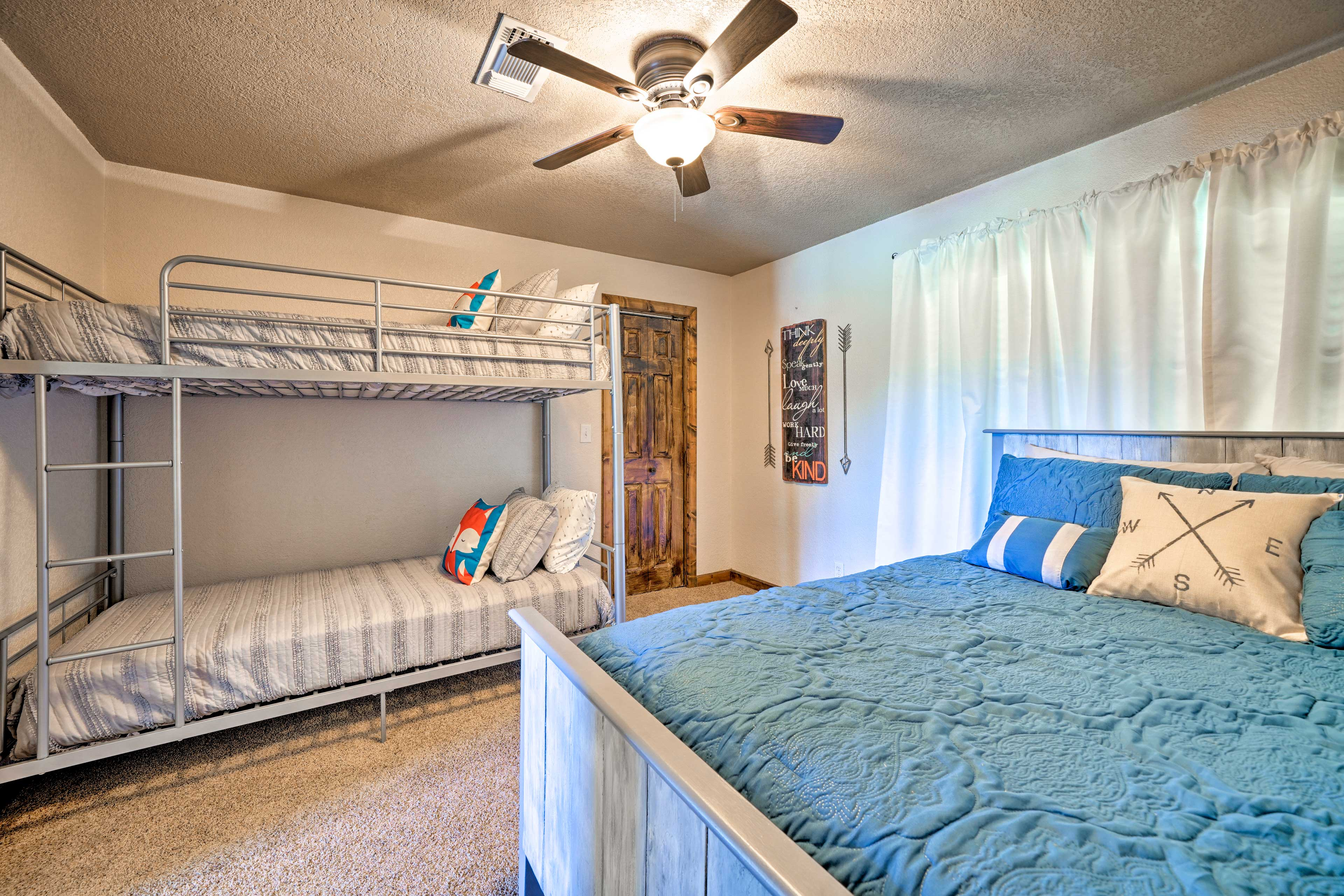 The second bedroom boasts a queen bed and twin-over-twin bunk beds.