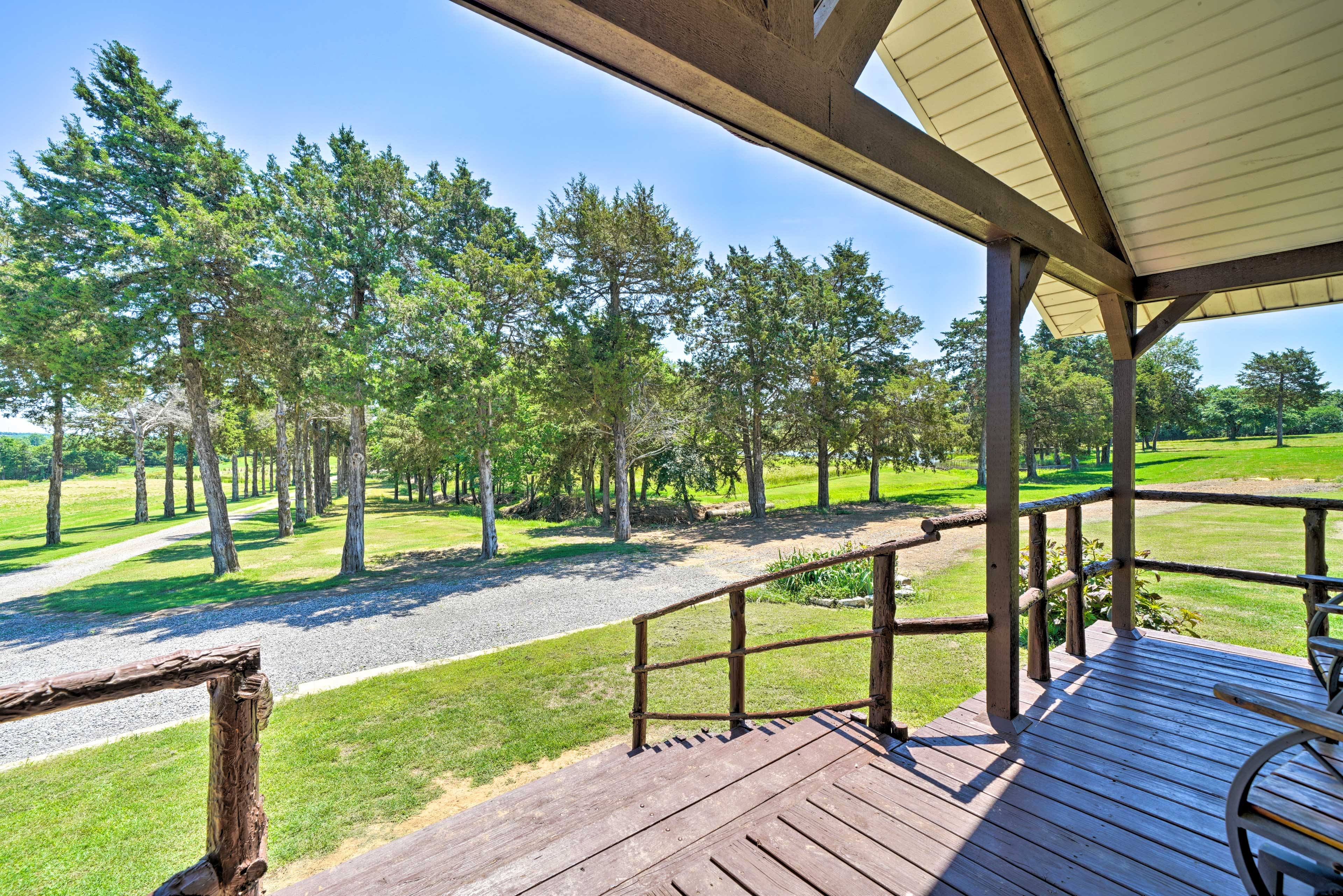 Take it easy in a rocking chair on the shaded front porch overlooking the ponds.