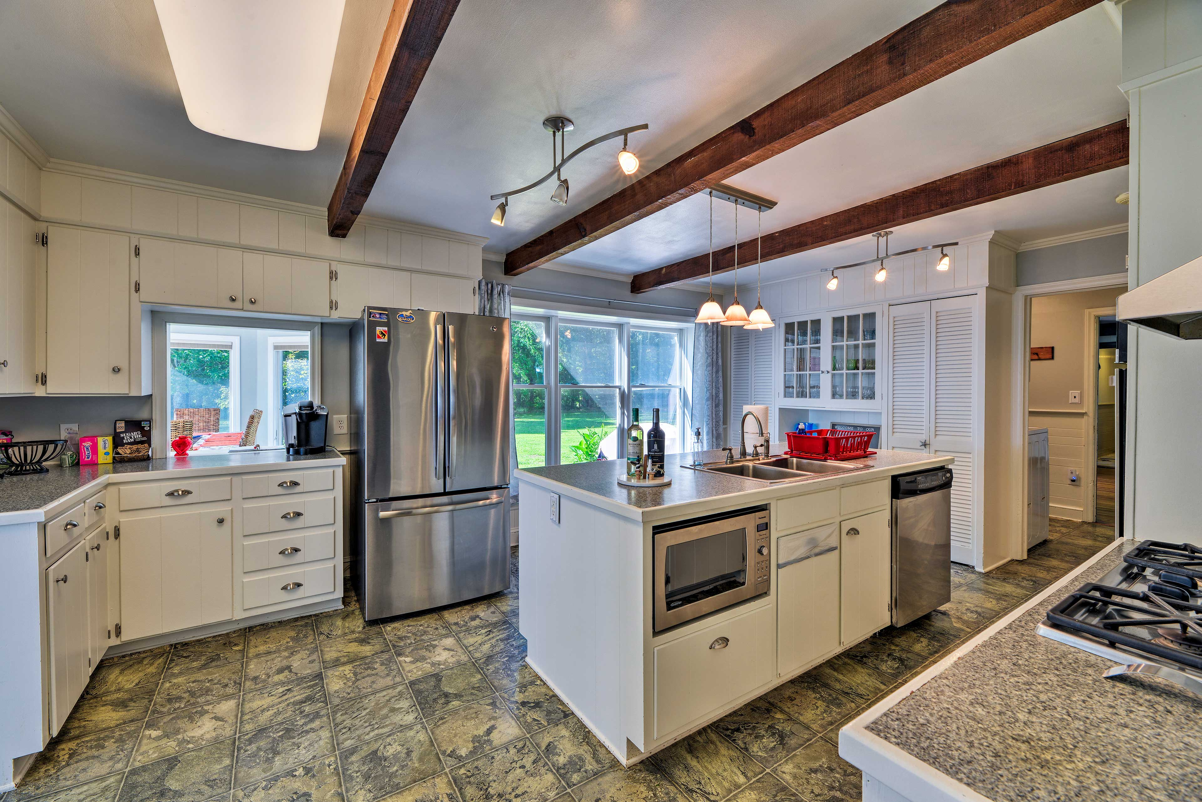 Step into the fully equipped kitchen to prepare a feast.