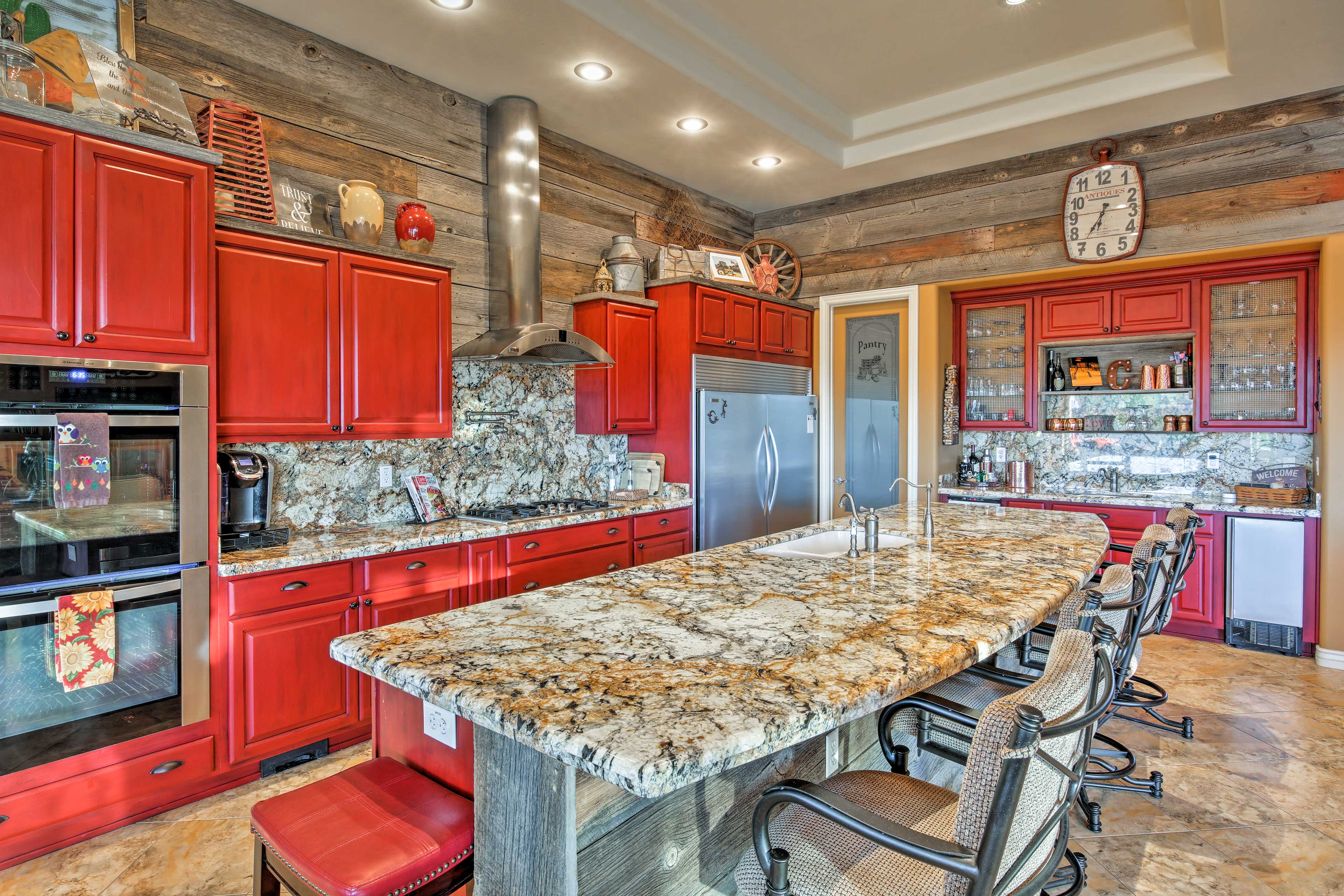 The open floor plan interior features sumptuous decor and marble finishes.