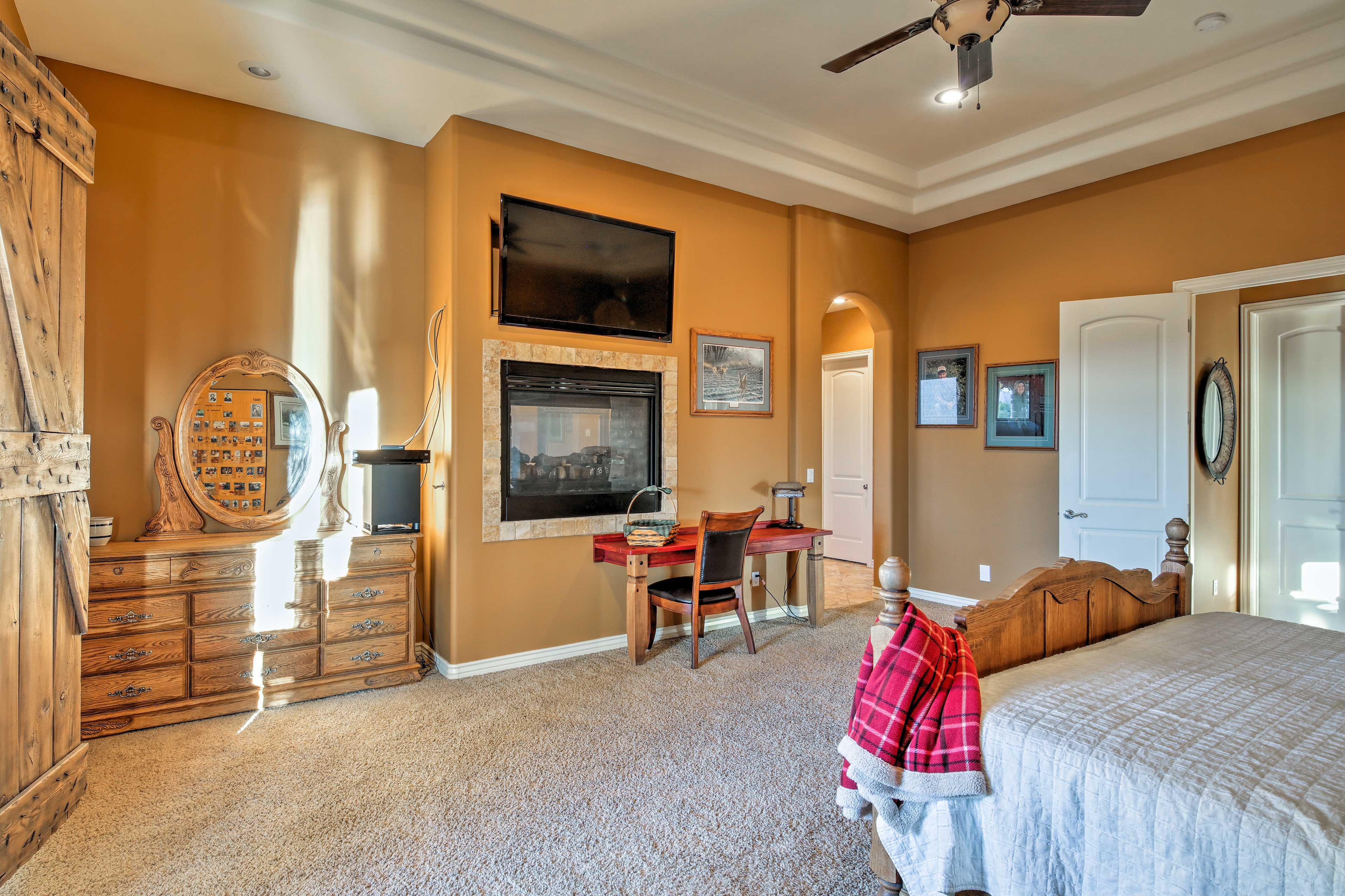 The bedroom boasts a queen bed, gas fireplace and flat-screen TV.