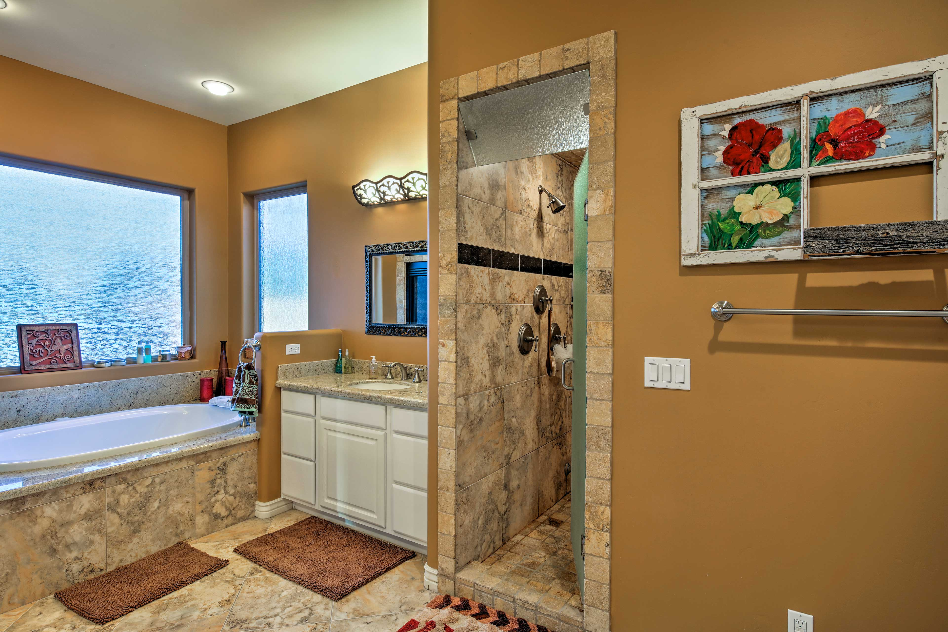 Treat yourself to a bath in the sunken jetted tub furnishing this bathroom.