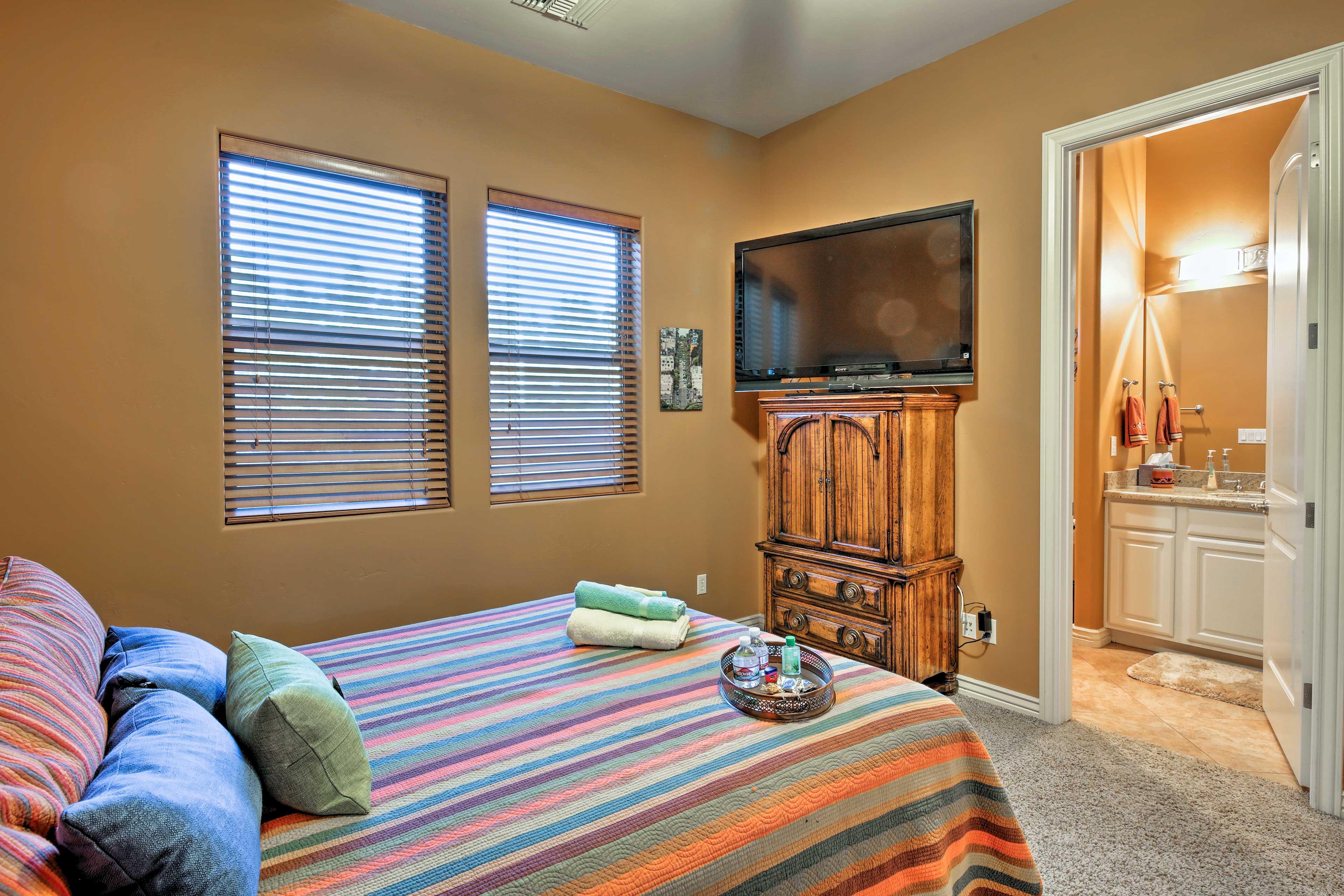 The bedroom features 2 windows, a flat-screen TV and en-suite bathroom.