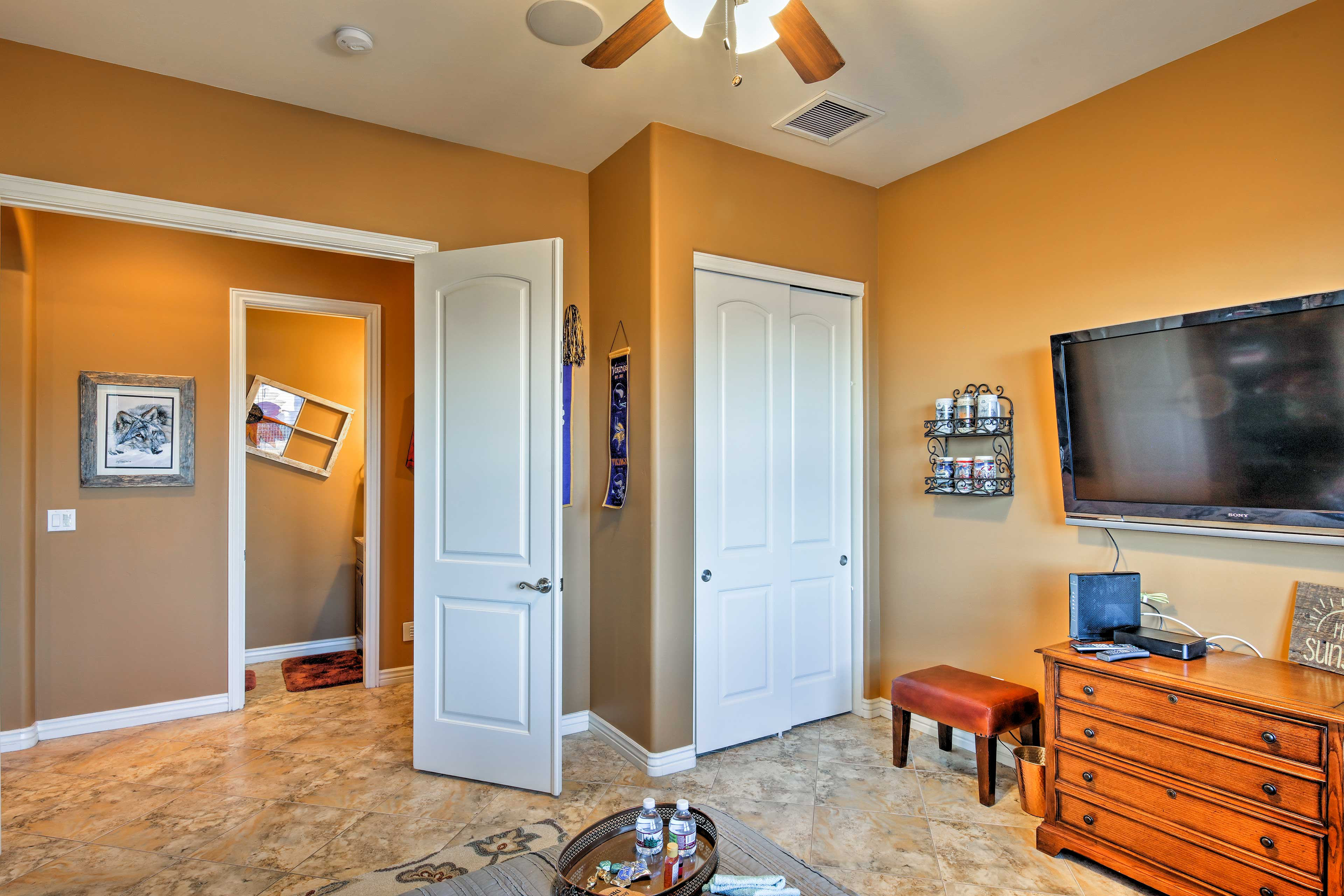 The bedroom boasts a large closet and flat-screen TV.