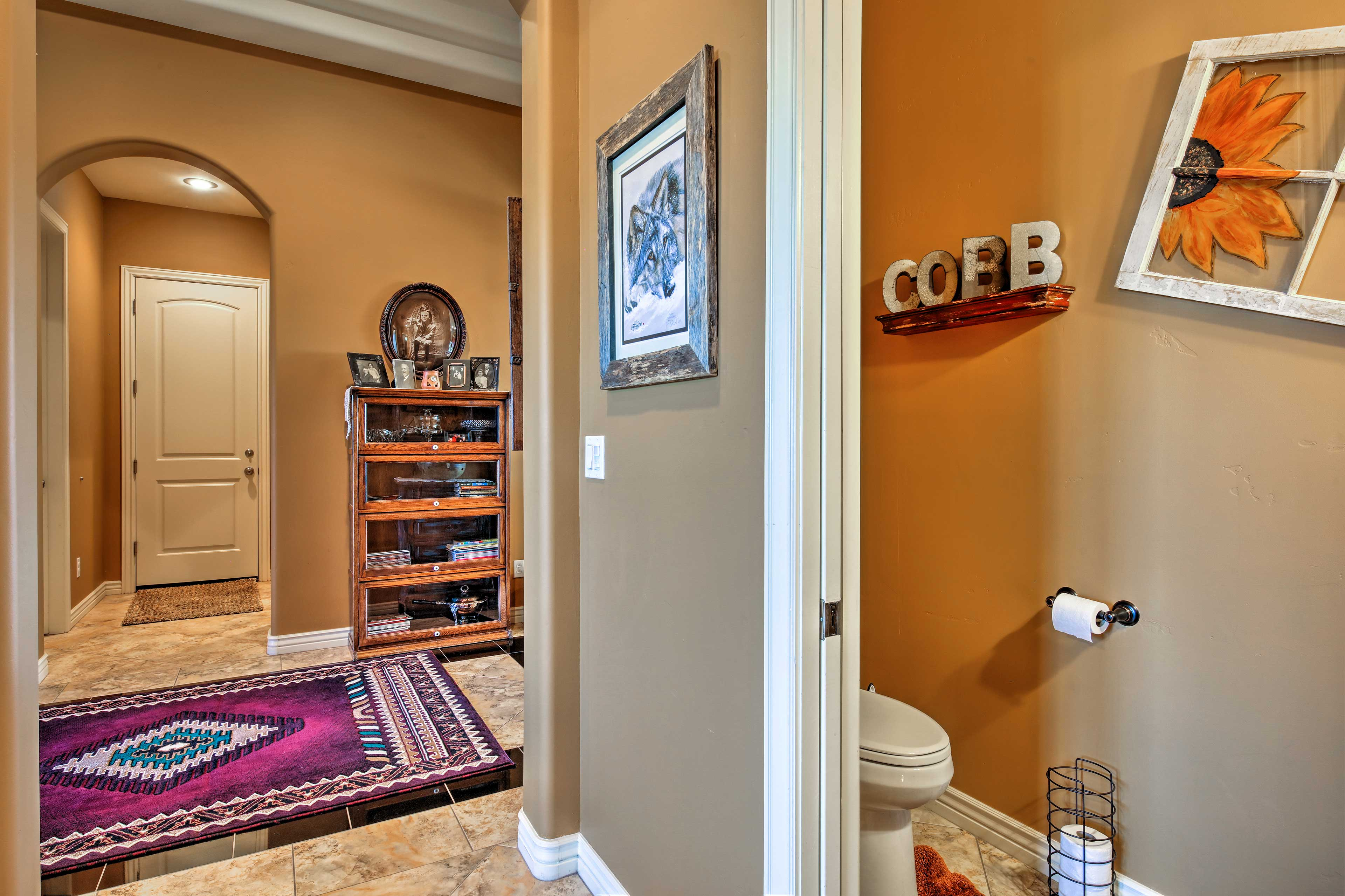 The half-bathroom is conveniently located just off the main living area.