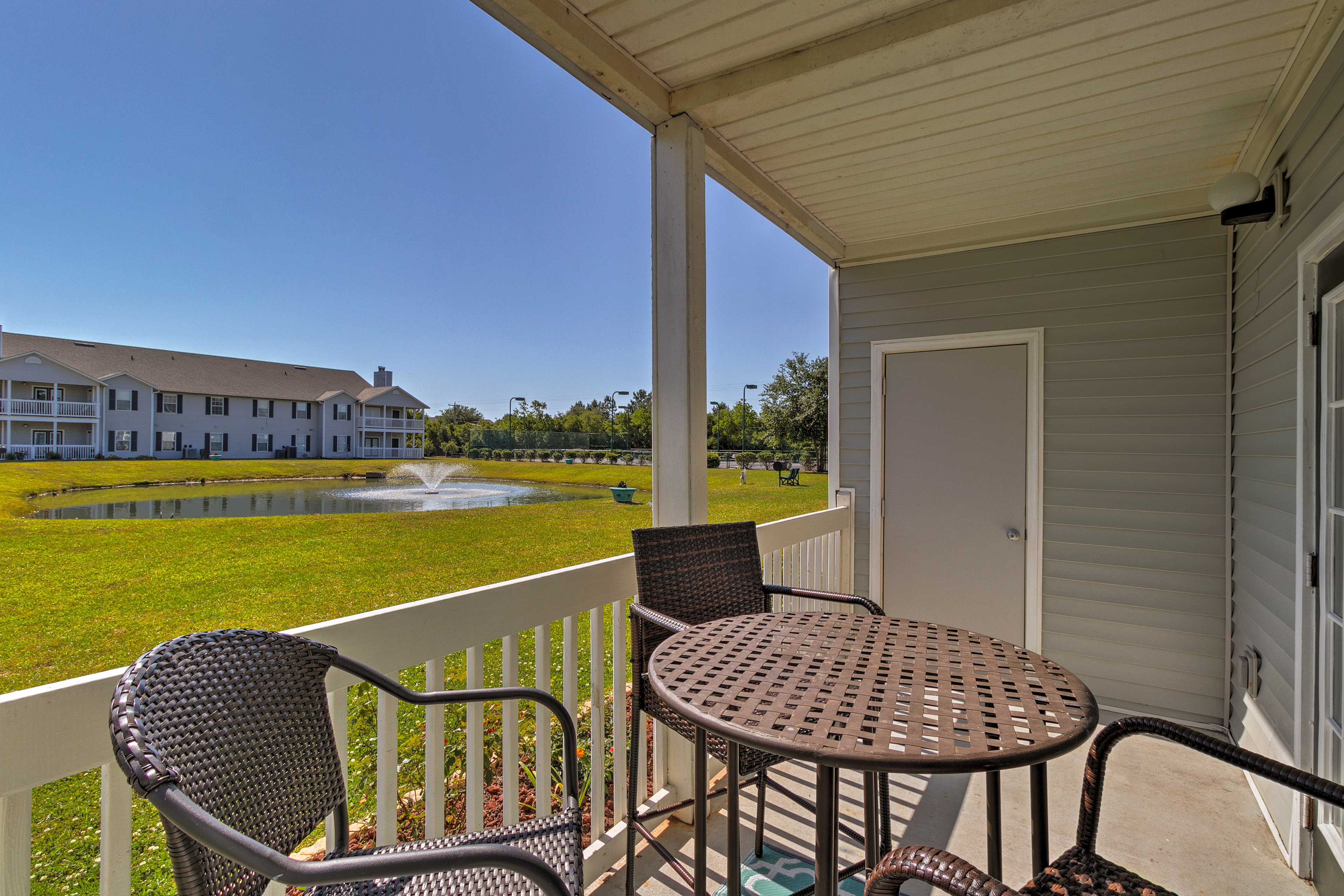 Relax on the private patio and enjoy the vibrant scenery!