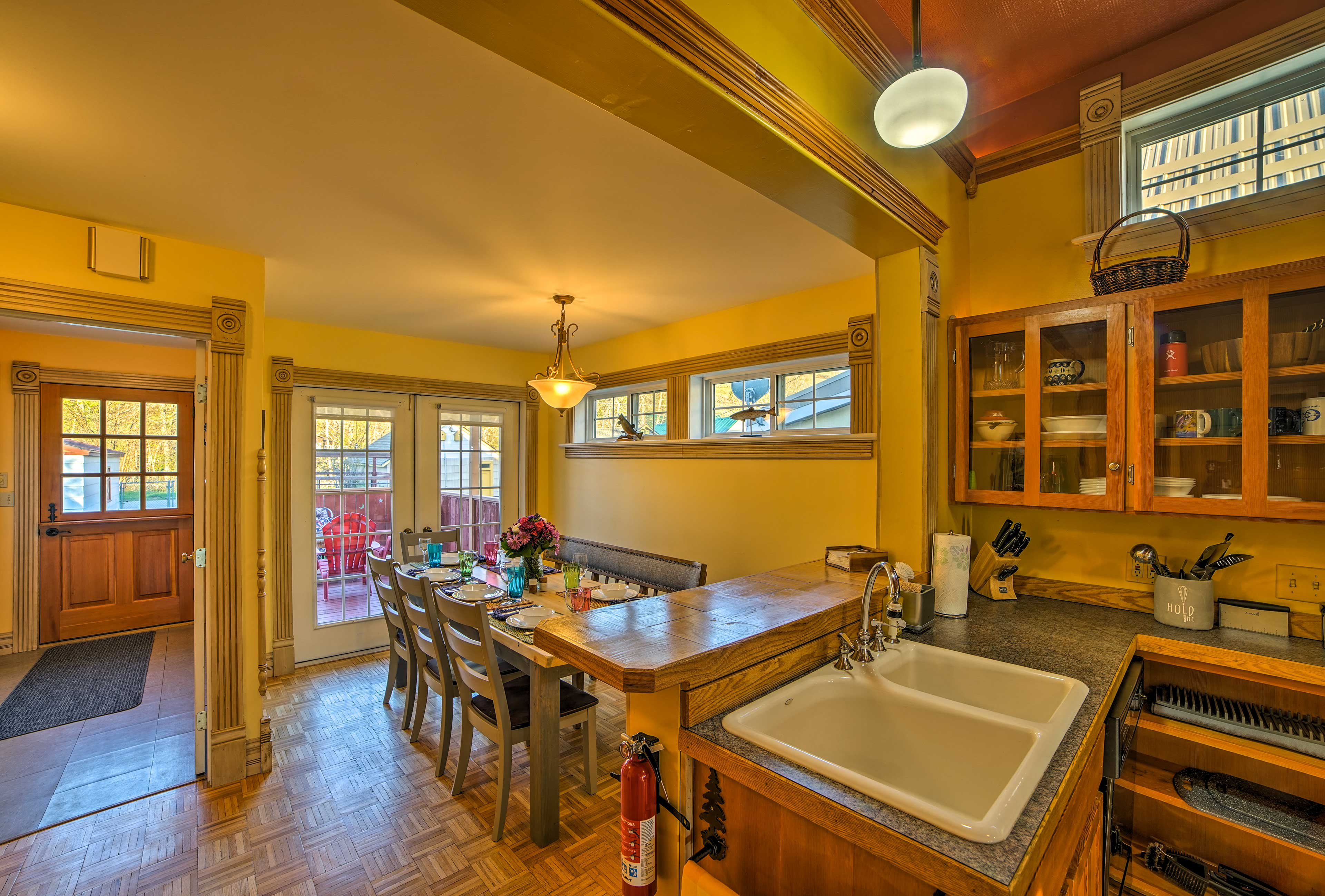 Wash up in the farmhouse-style sink after dinner at the large dining table.