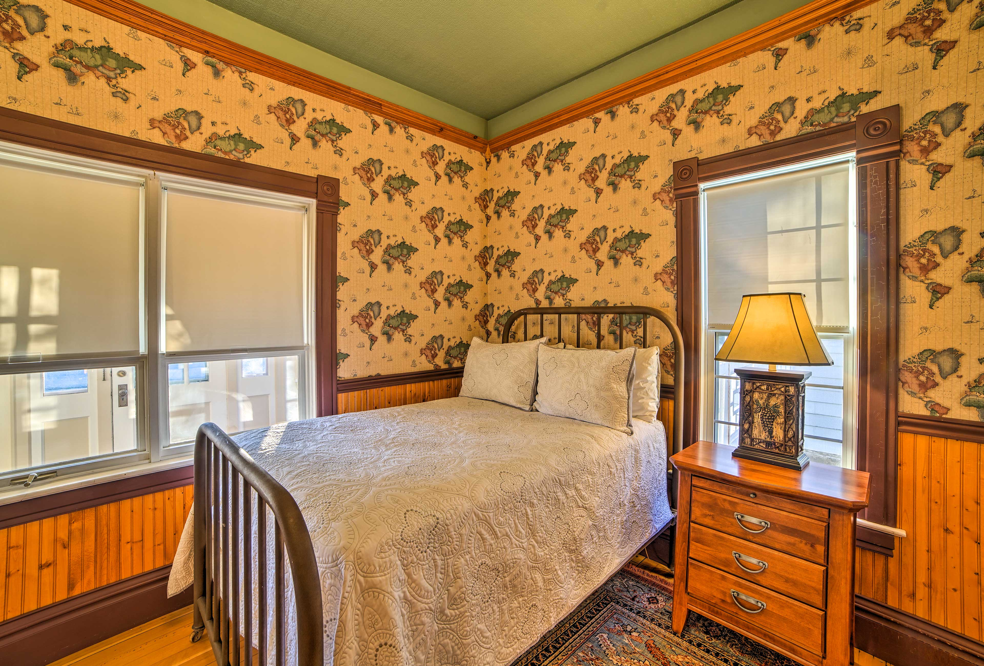 This bright, homey room features a full-sized bed.