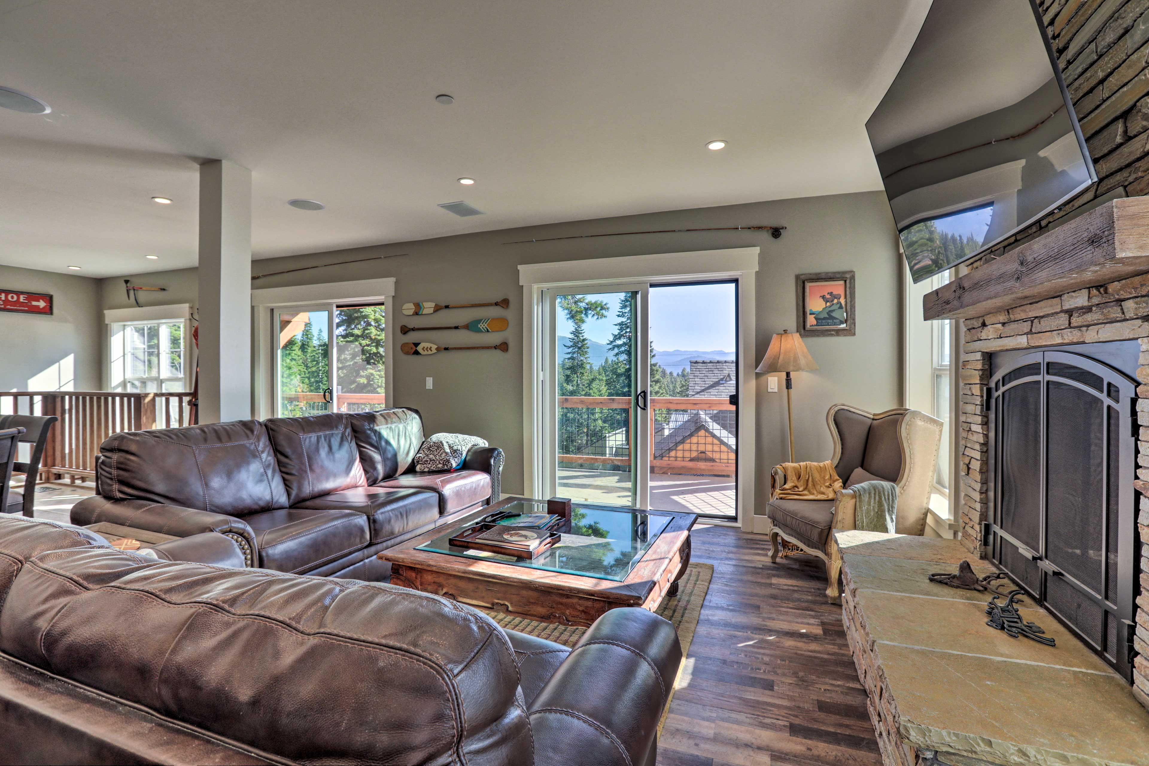 Sunlight and mountain views fill the expansive living areas.