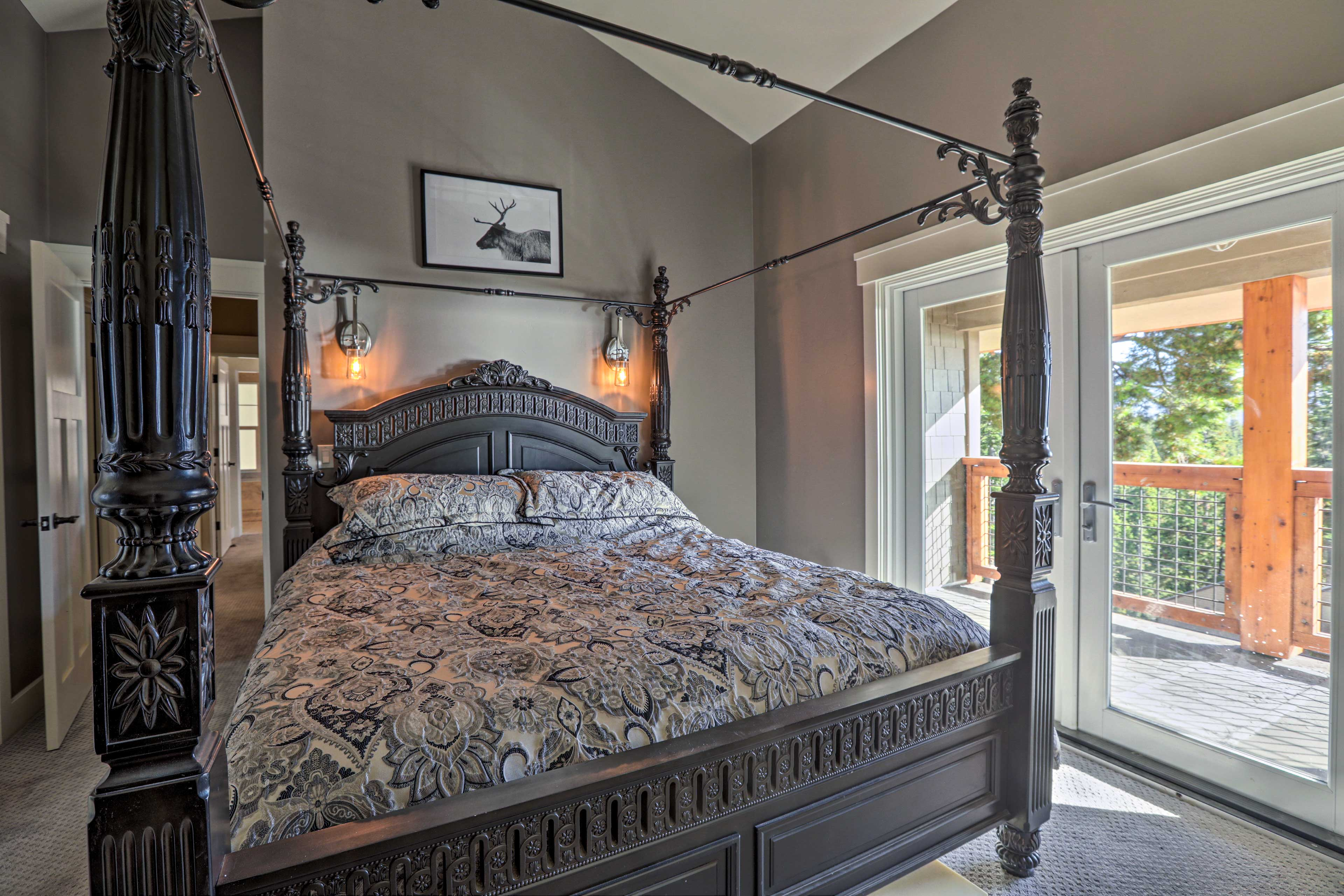 The fist master bedroom boasts a king bed and deck access.