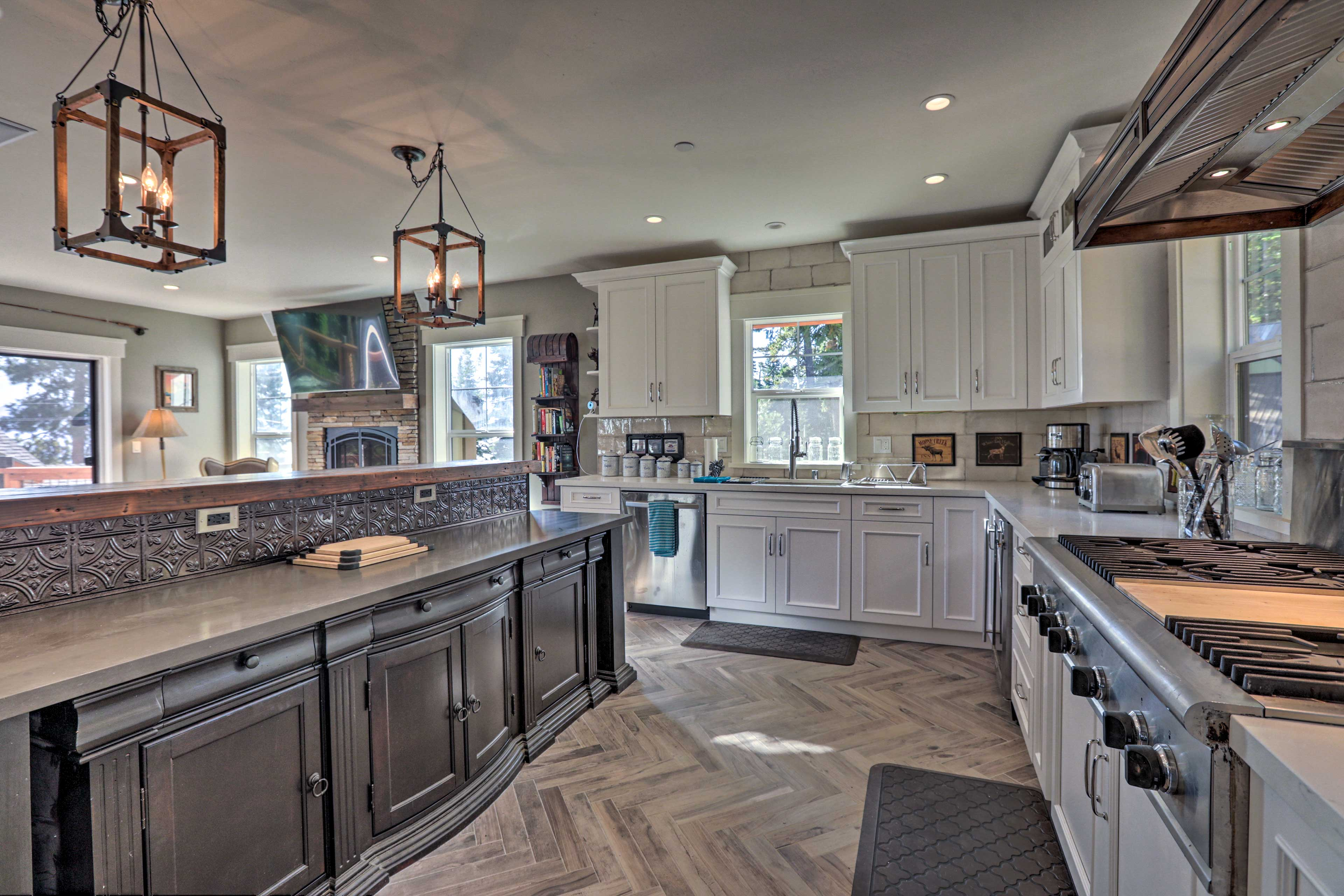 The gourmet kitchen is fully equipped and boasts ample counter space.