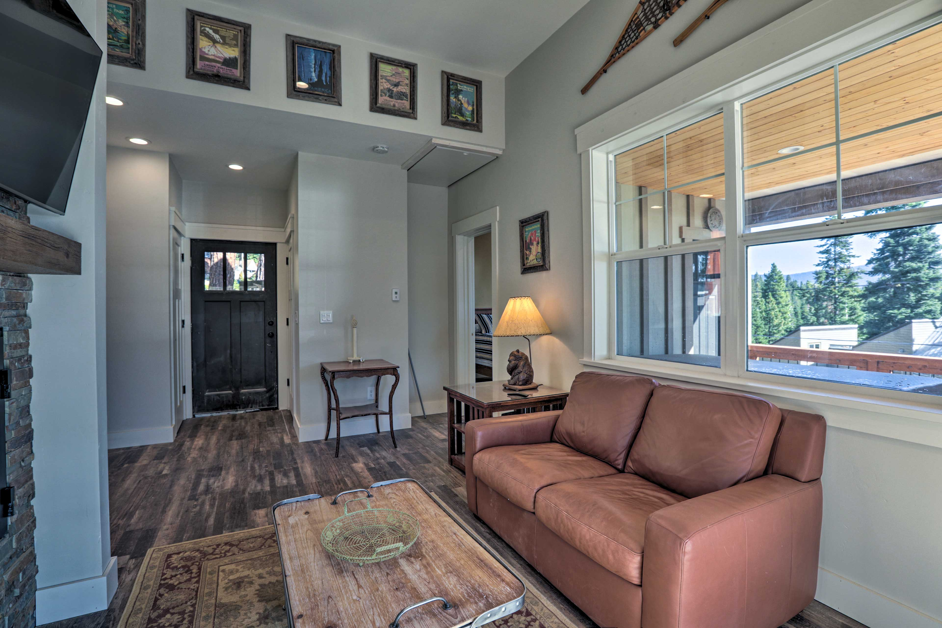 There's an additional living area with a flat-screen TV and a fireplace.