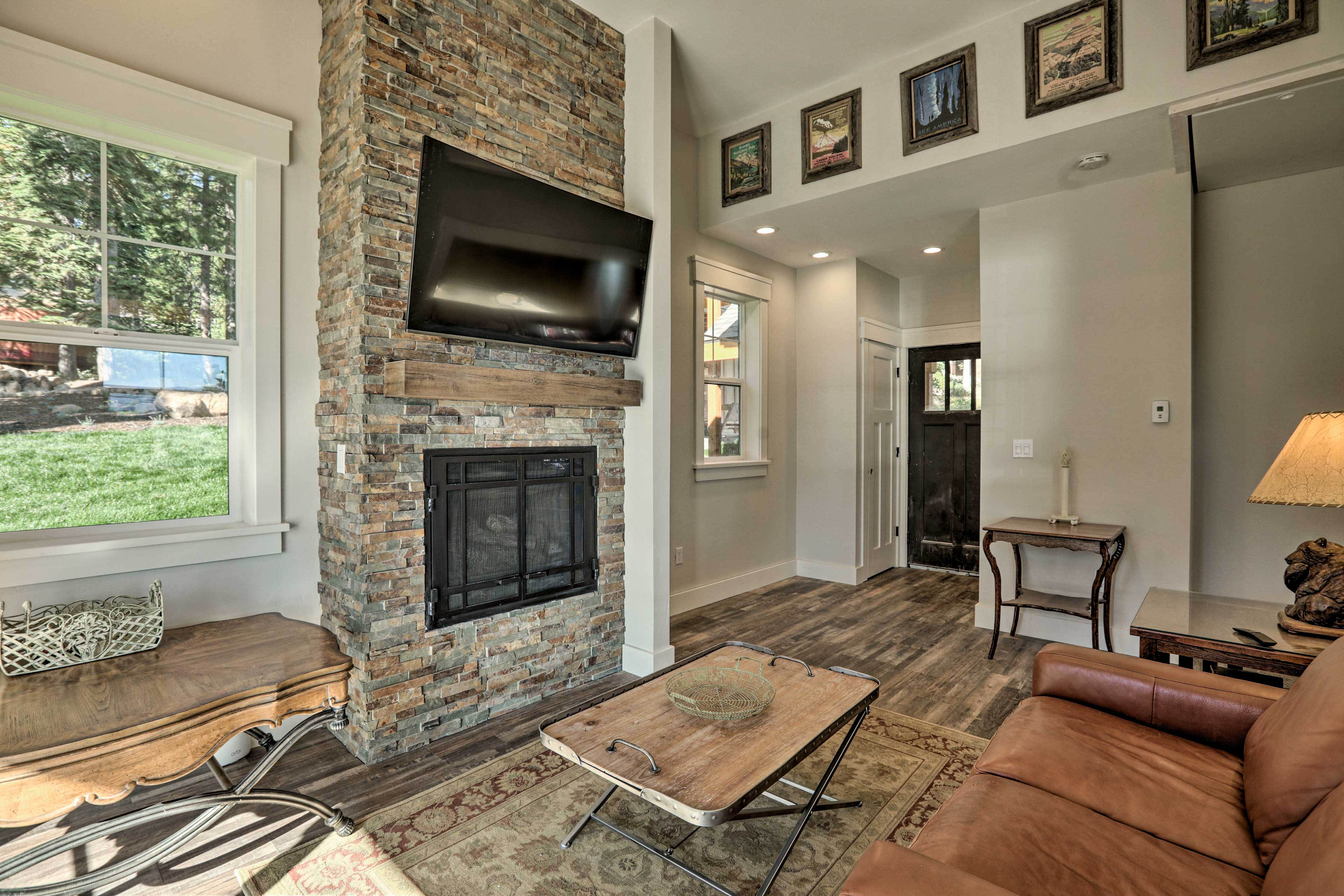 Cozy up to the fireplace while you watch a movie in your private Guest House!