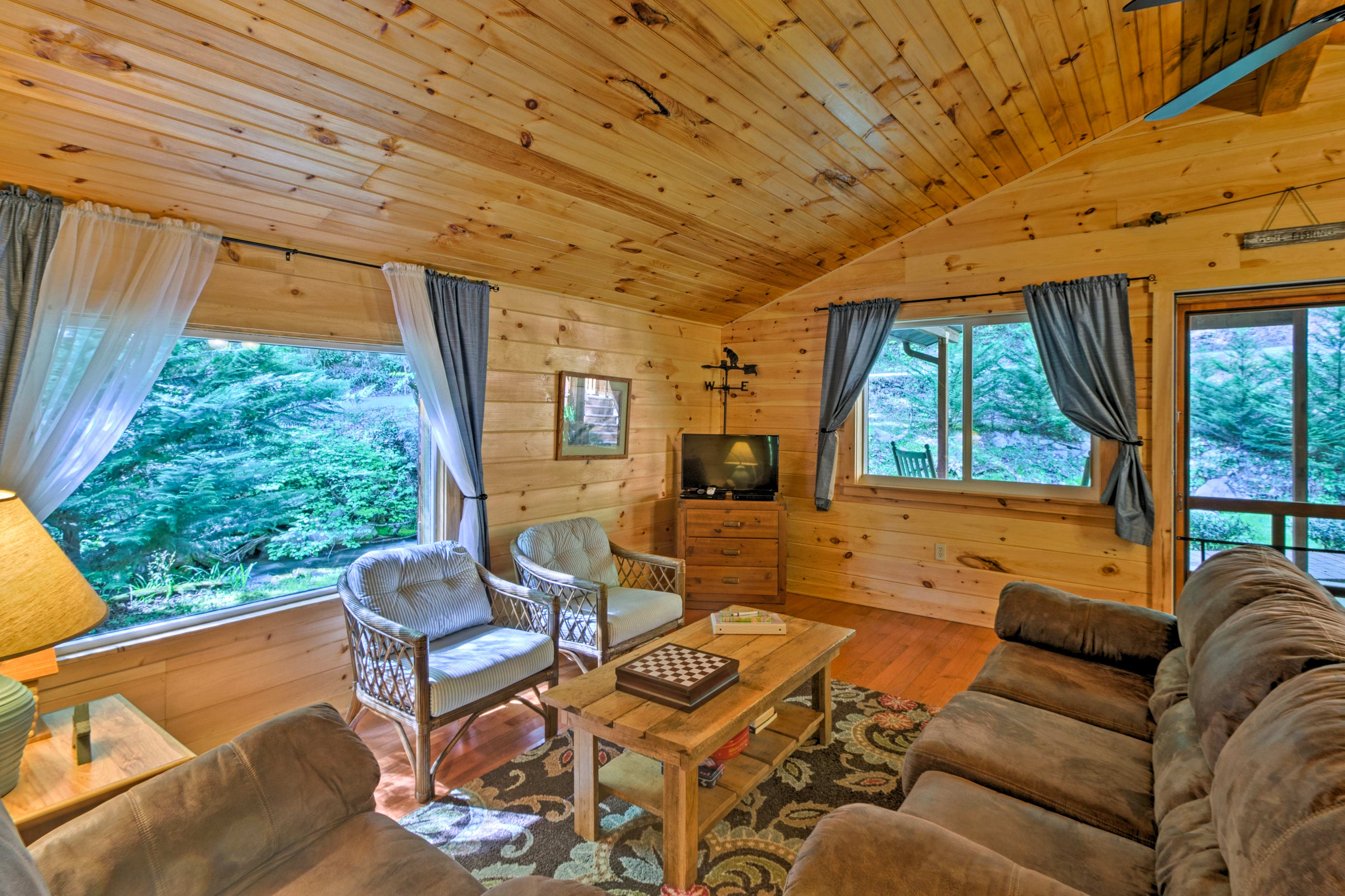 Take in the scenic forest views from inside the comfort of the cabin.