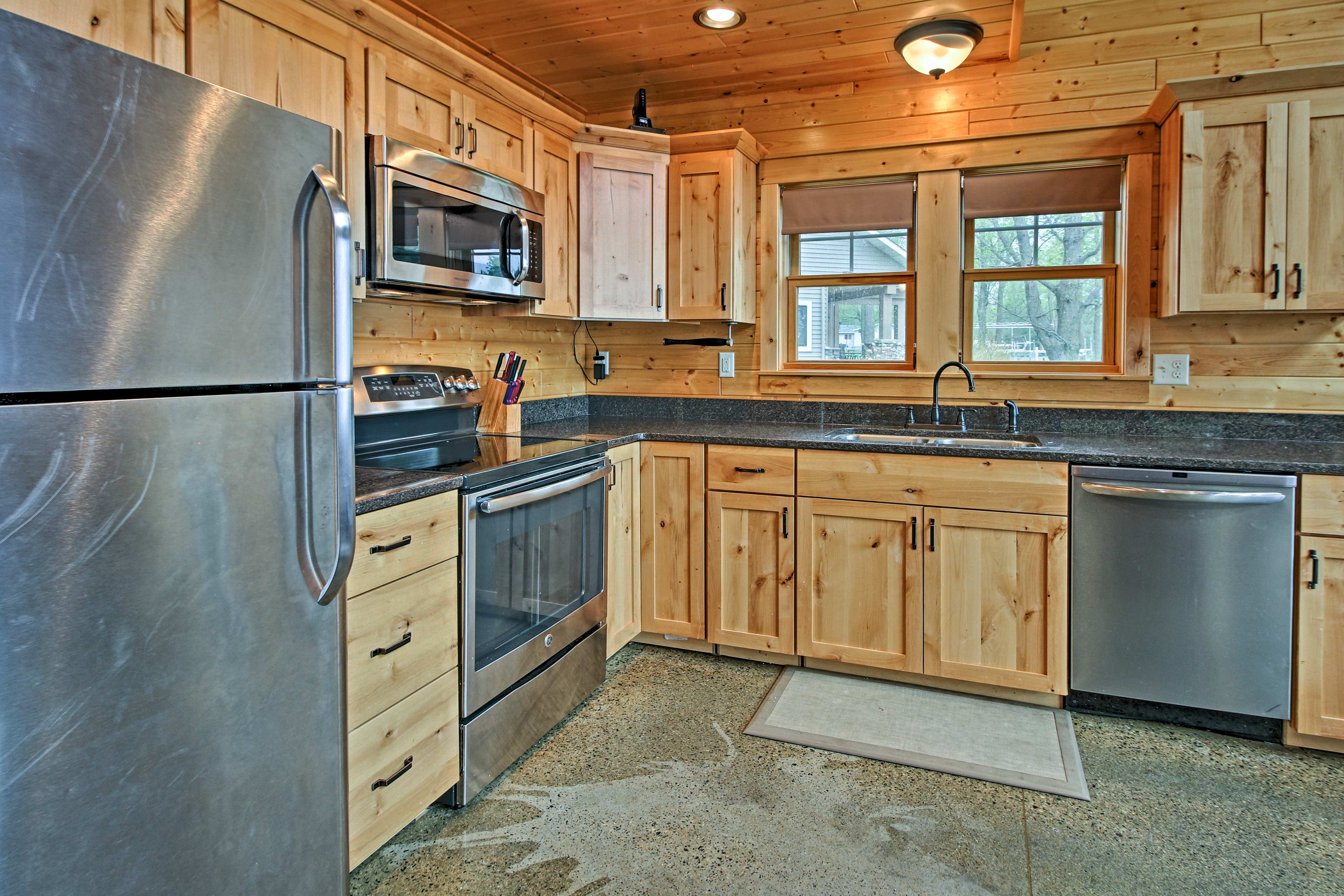 The living room opens up to the fully equipped kitchen.
