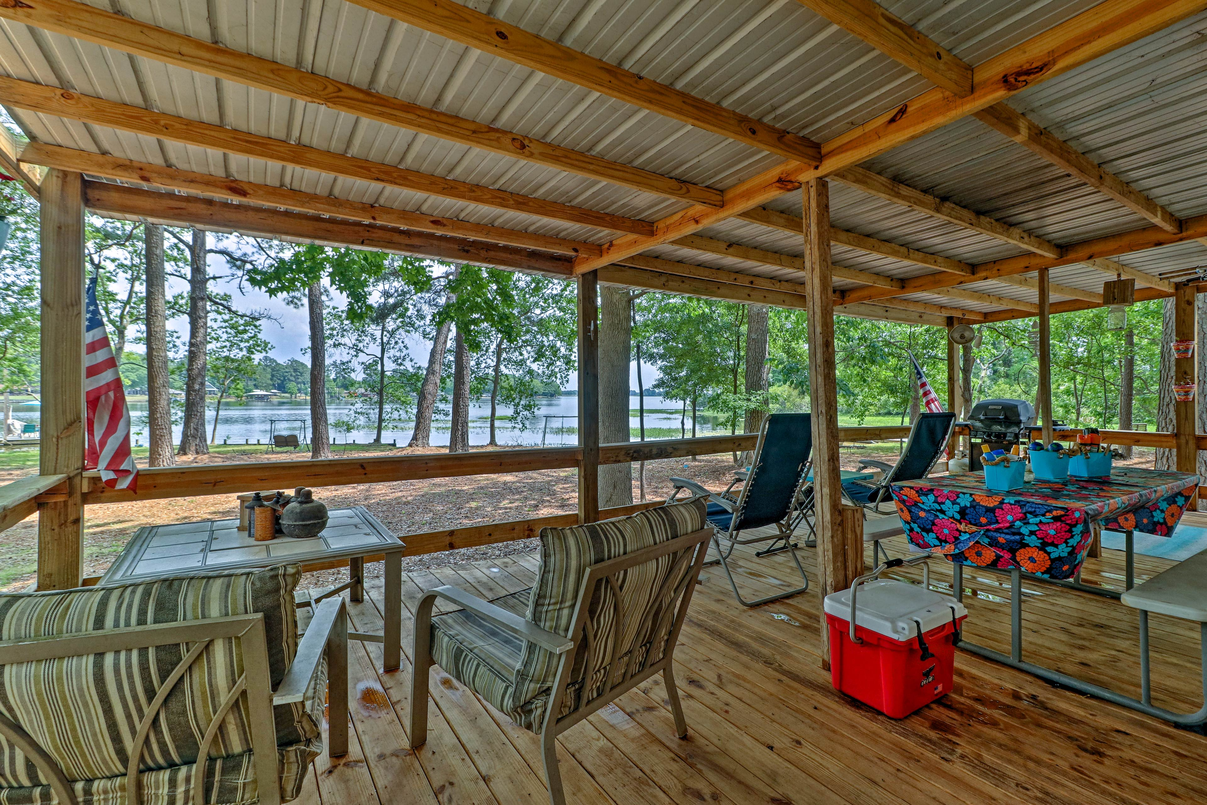 Soak in your lakefront location from the furnished covered porch.
