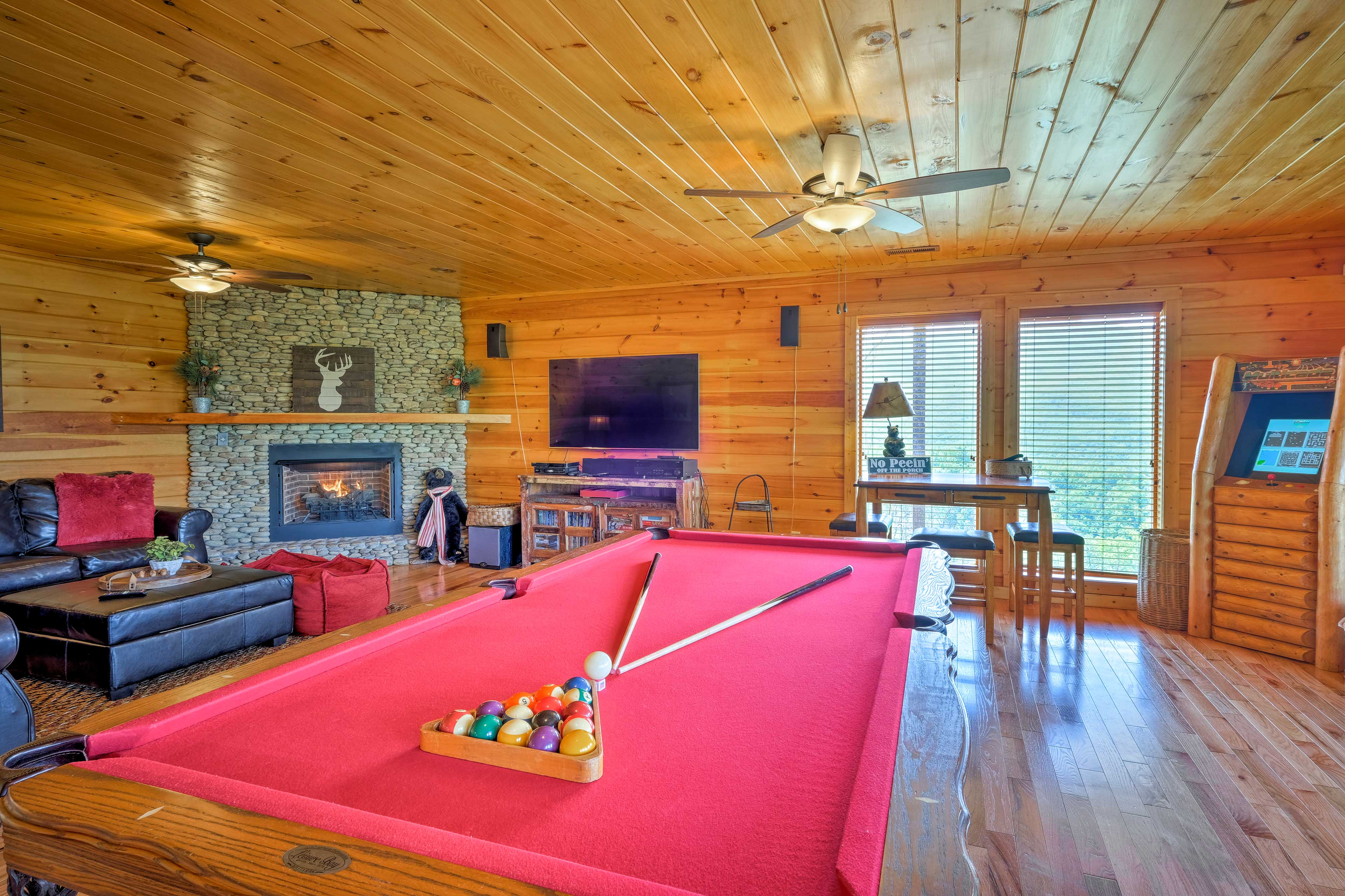 This massive cabin offers 4 bedrooms and 3 bathrooms, and fun for everyone!