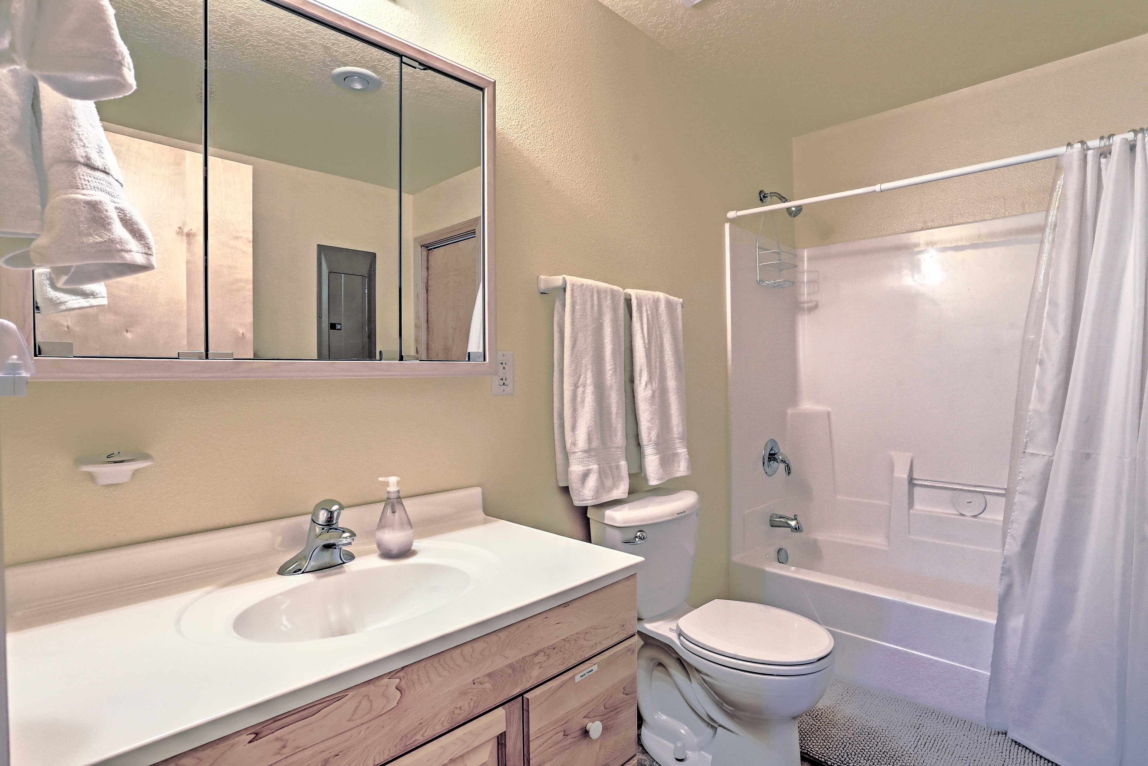 The en-suite bathroom includes a shower/tub combo.