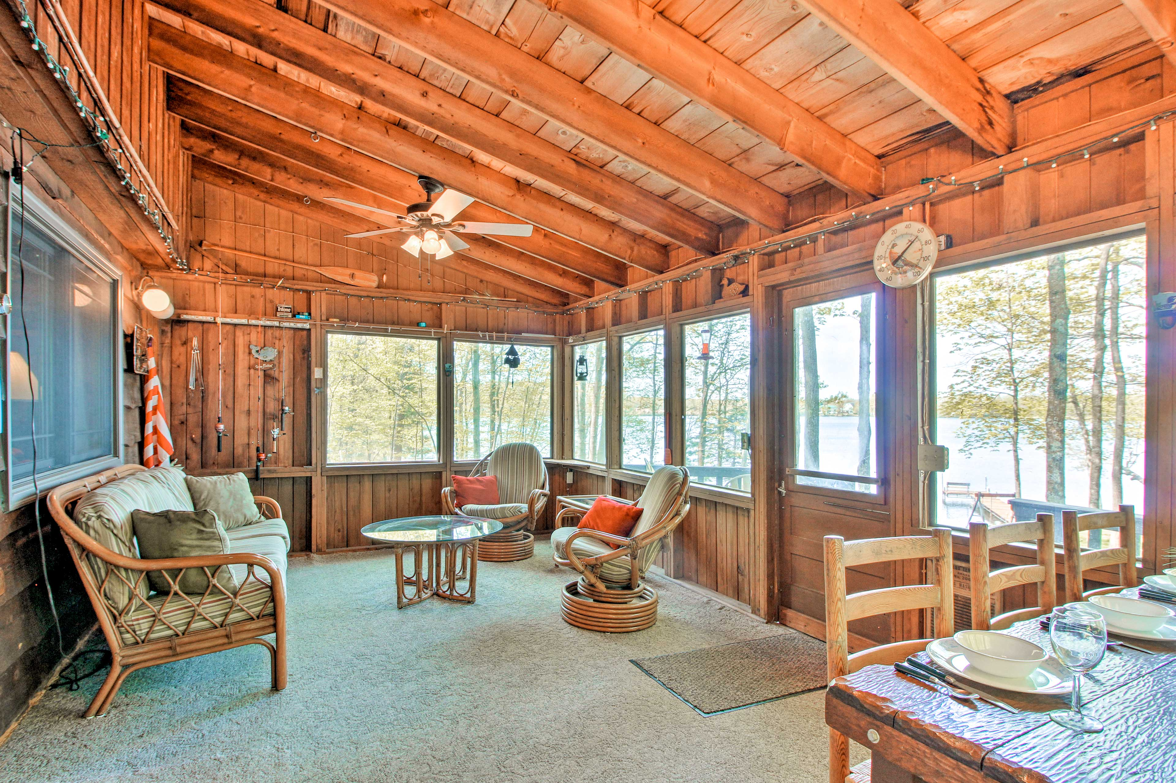 With wall-to-wall windows, the sunroom is a great place to gather.