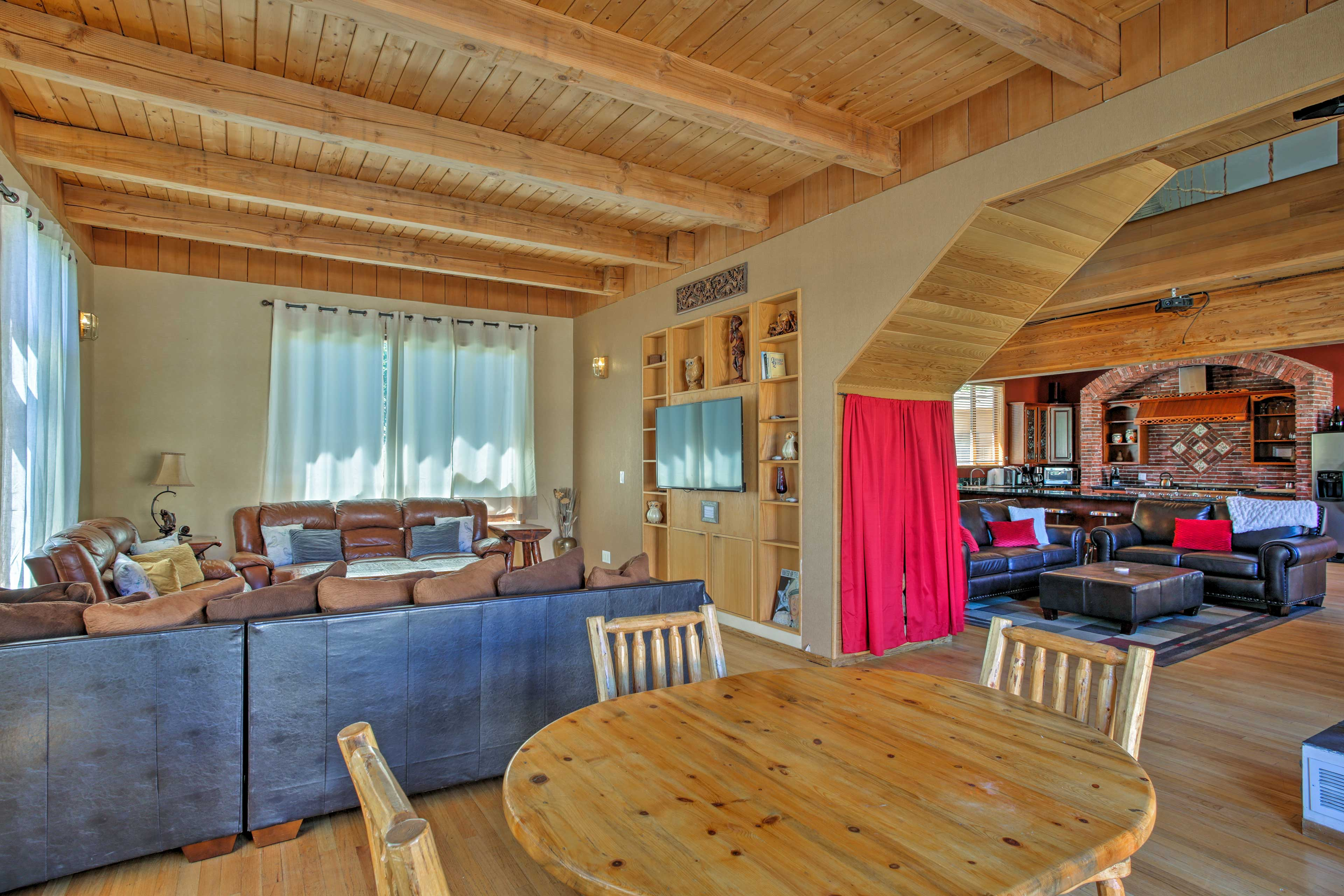 Plush leather couches & wood detailing complete this epic mountain retreat.