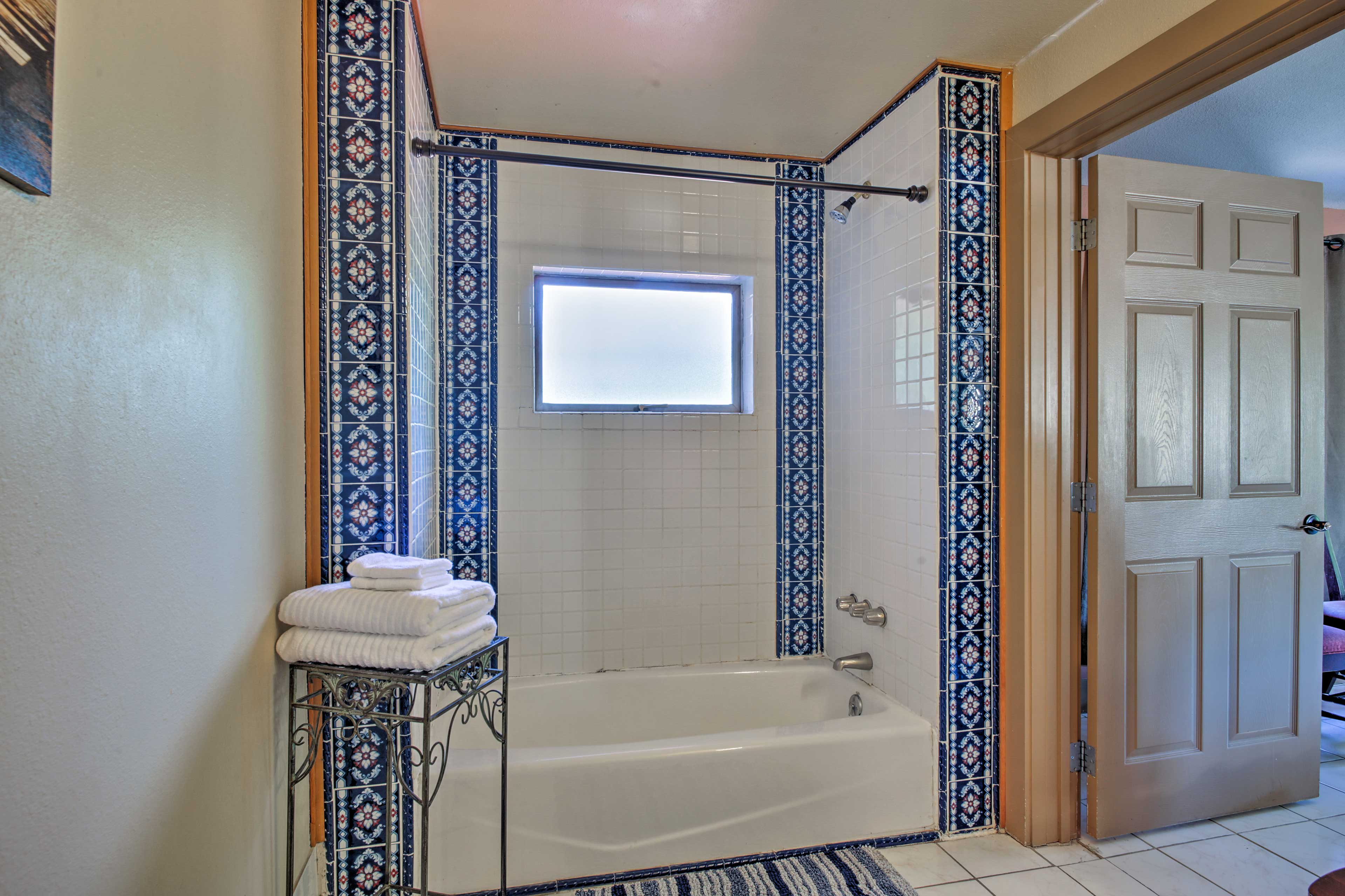 There's even a shower/tub combo with intricately patterned tile work.