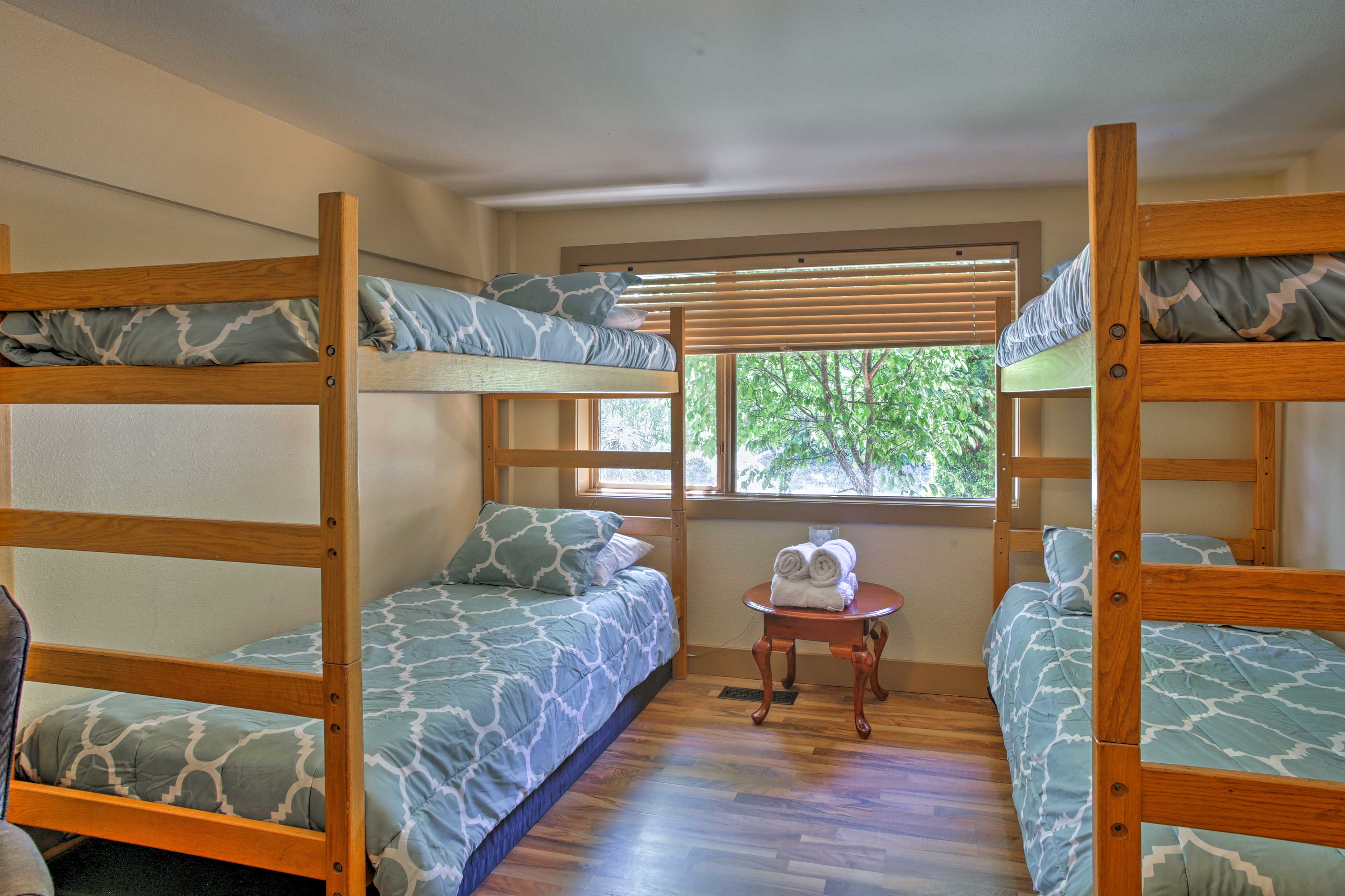 A second room with twin-over-twin bunk beds lets the kids stay close.
