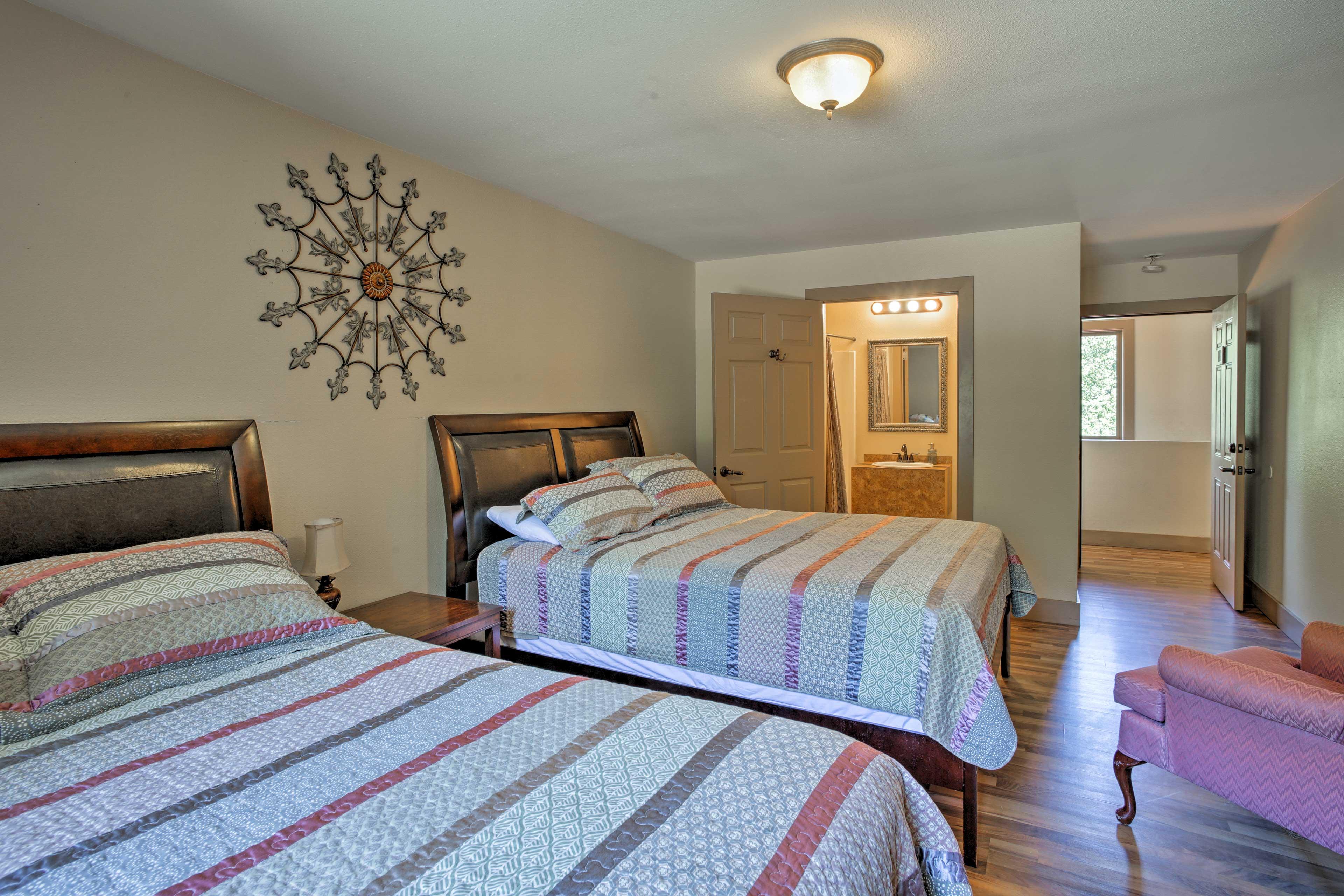 Another bedroom has 2 queen beds that promise peaceful sleeping.