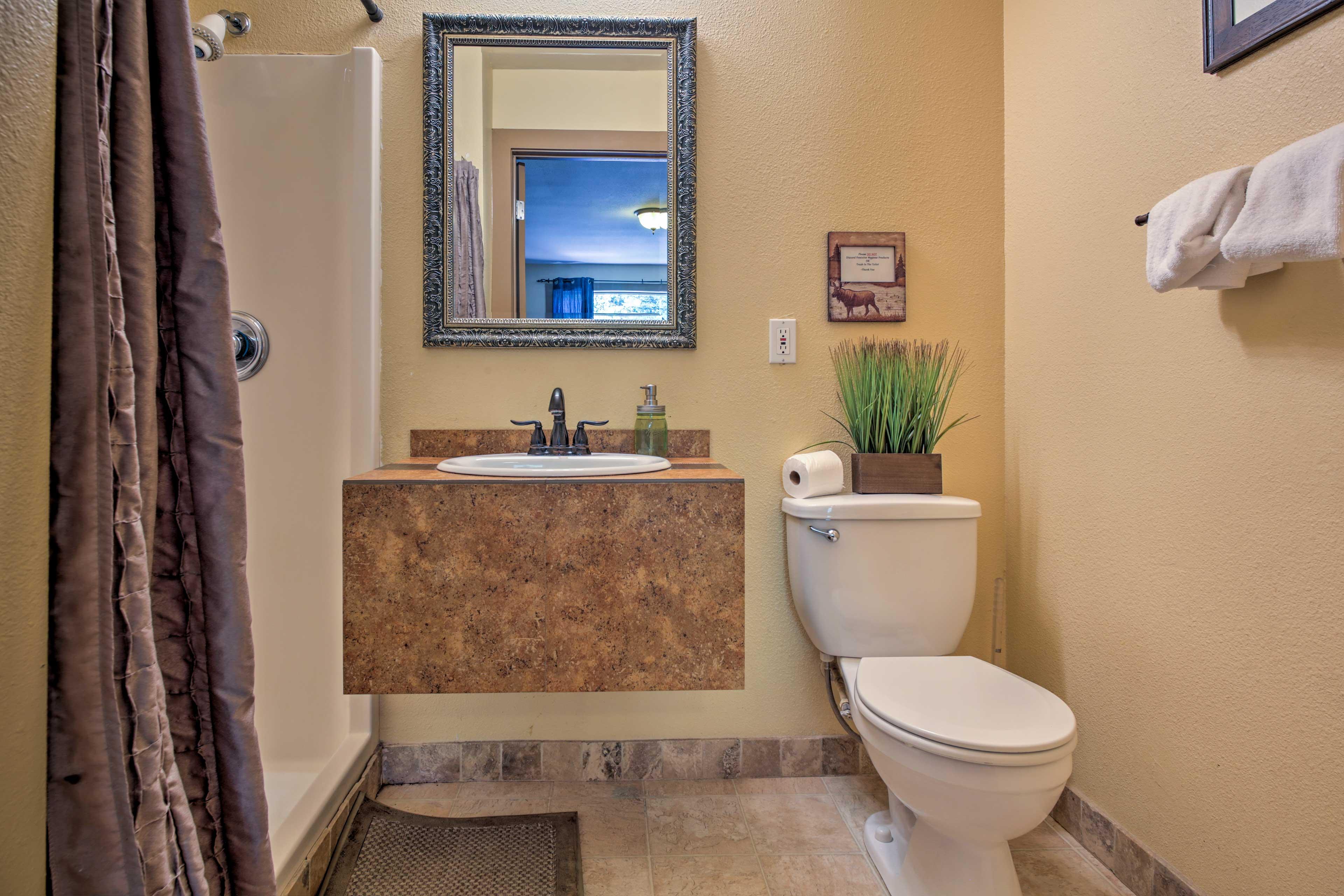 The en-suite full bathroom has a walk-in shower.