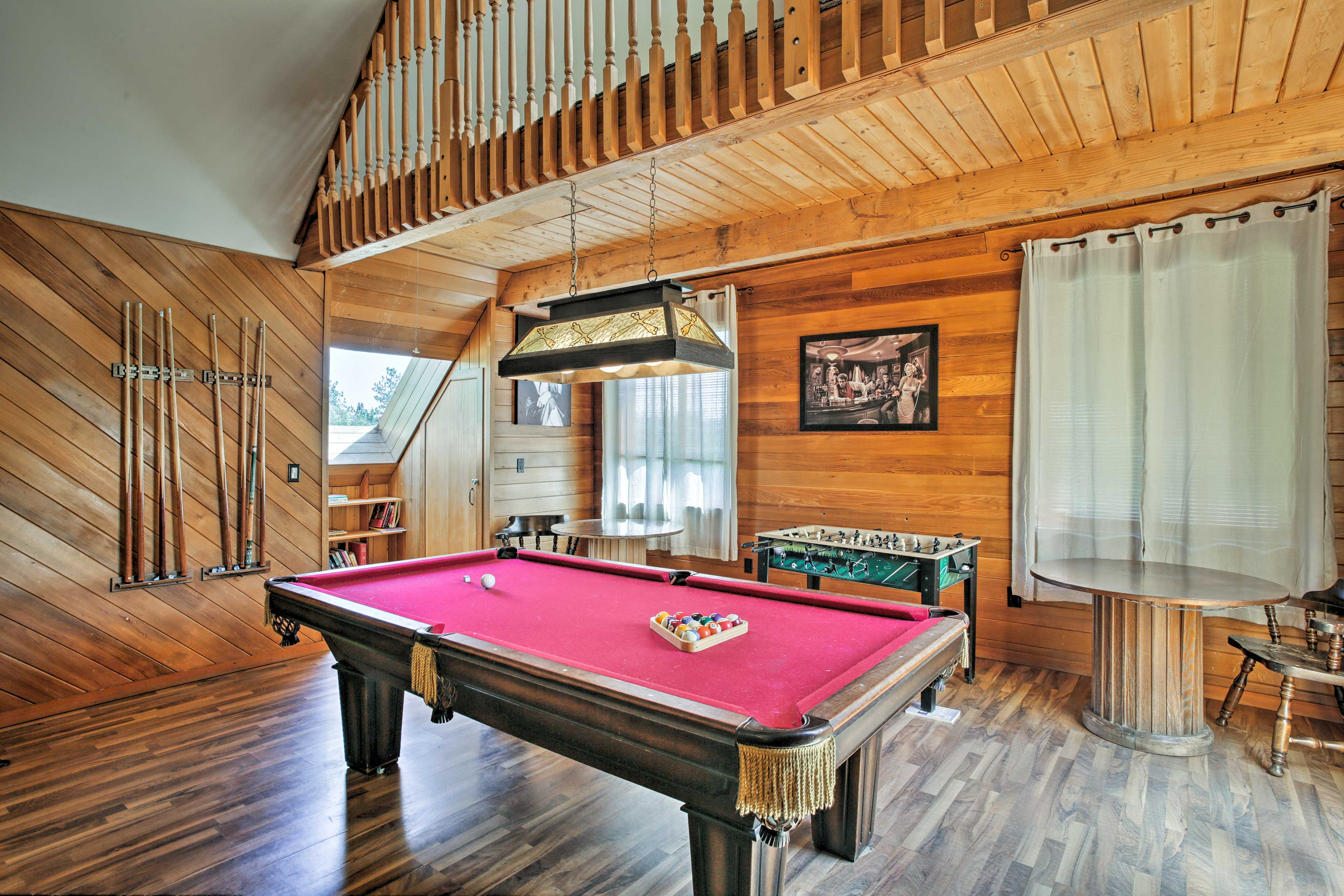 Upstairs, the game room boasts a pool table & foosball table.