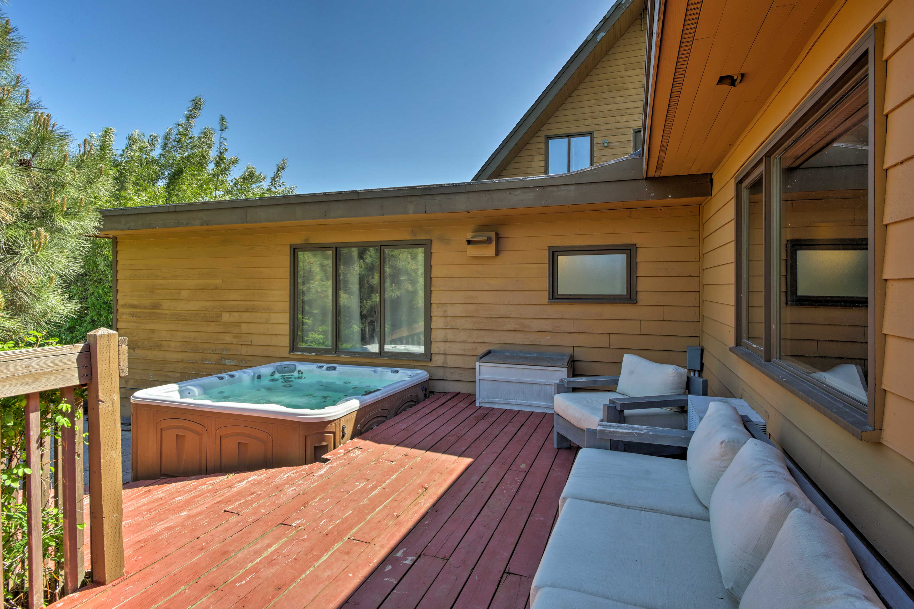 Plush seating lets you relax beside the 8-person hot tub.