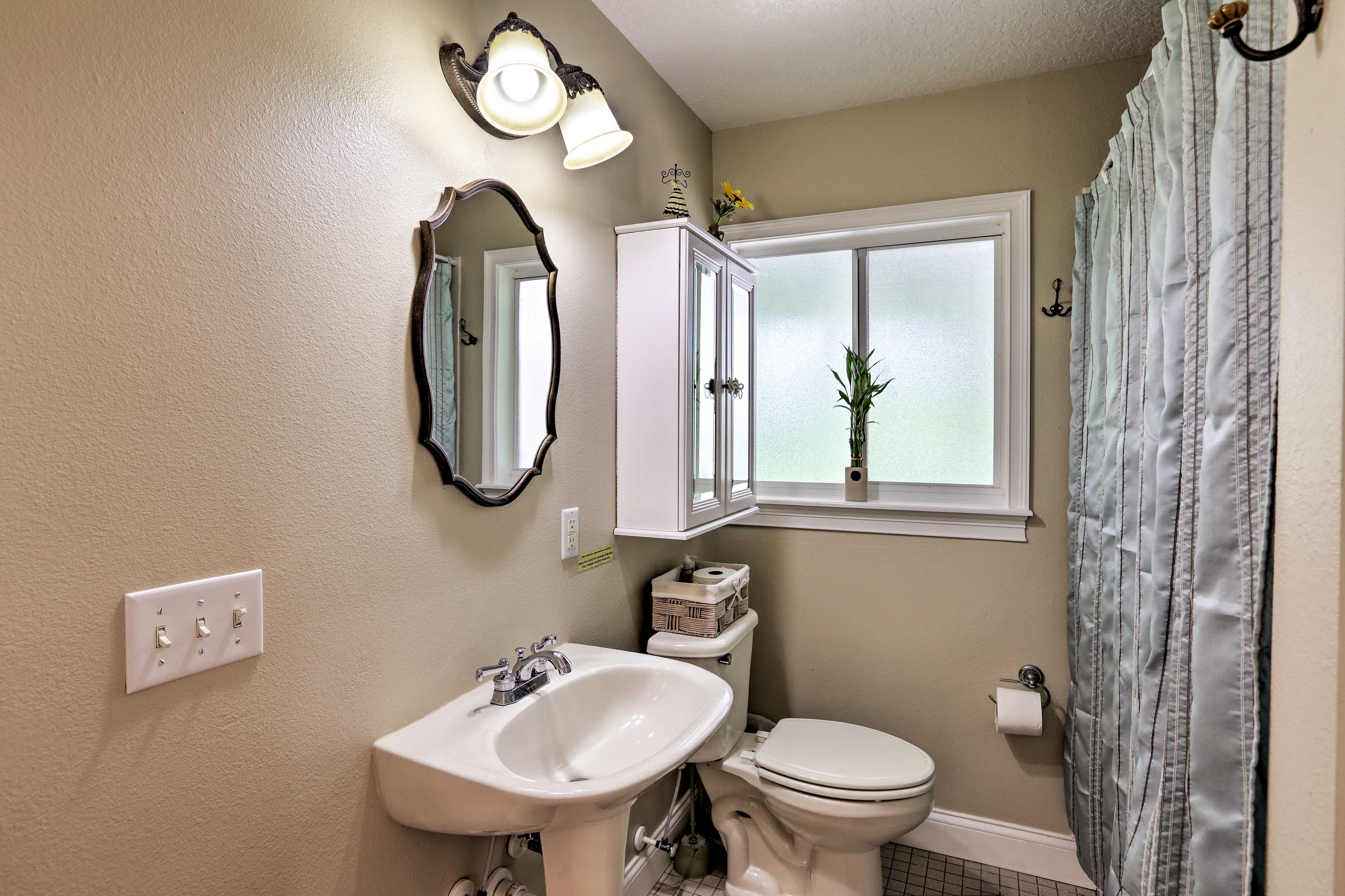 An en-suite bath makes morning routines a breeze.