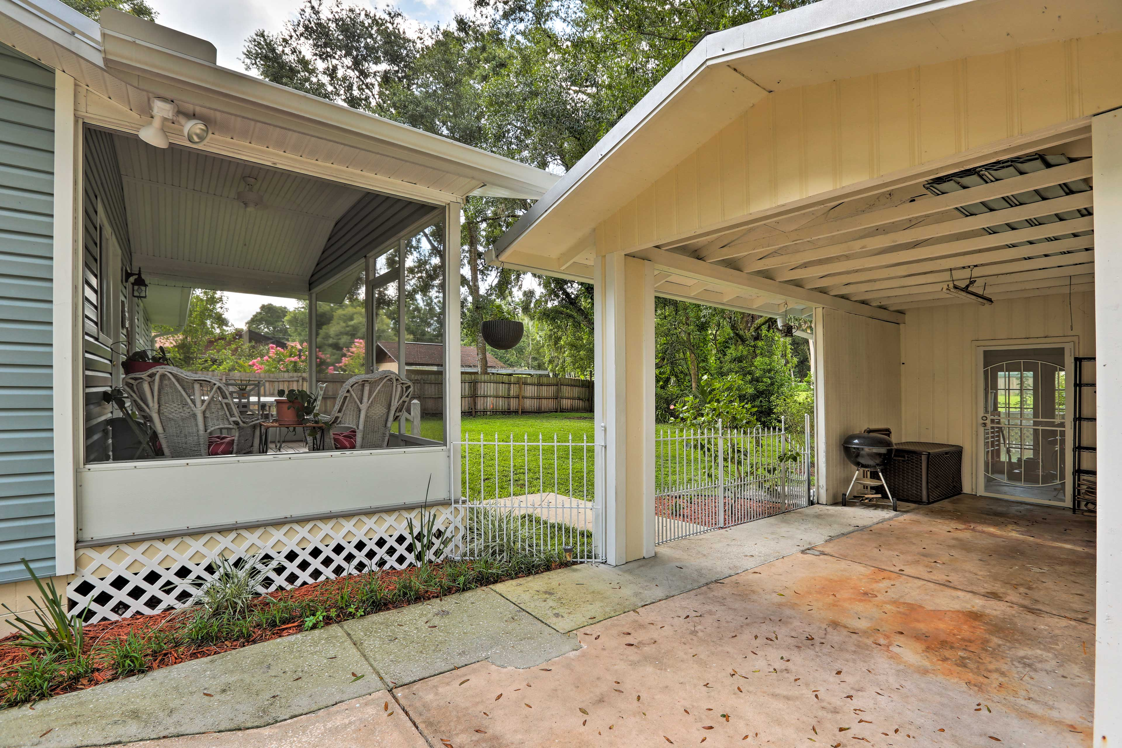 The carport can fit small trailers or motorcycles.